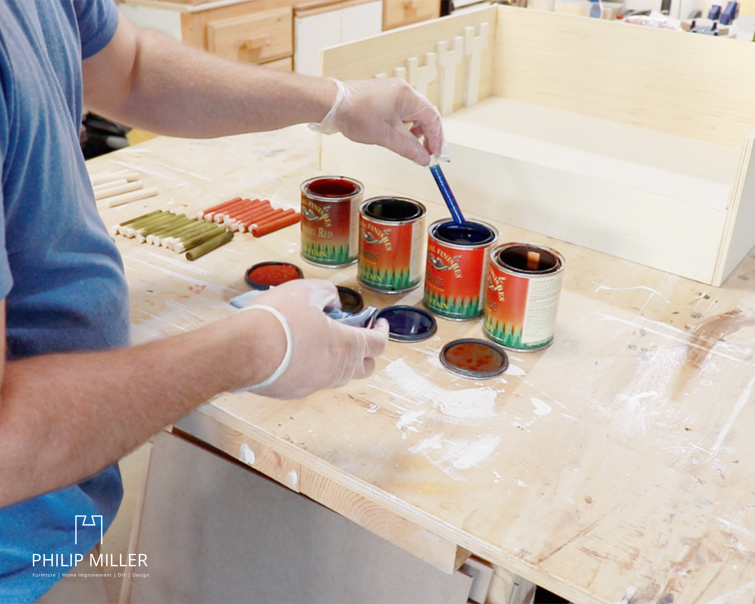 applying a General Finishes dye stain to the dowels for the ring toss game in my garage