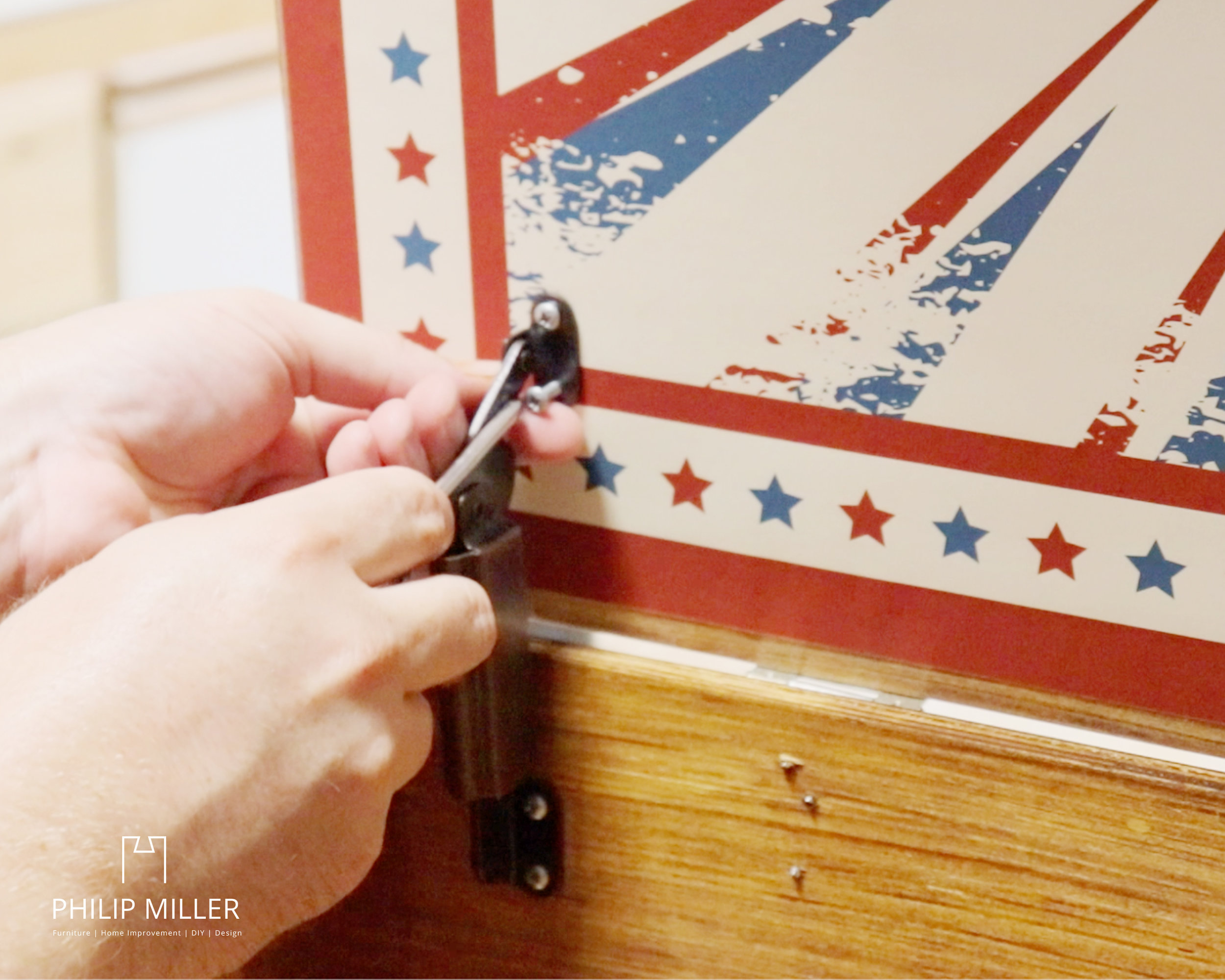 installing a toy box hinge for the lid of a ring toss game