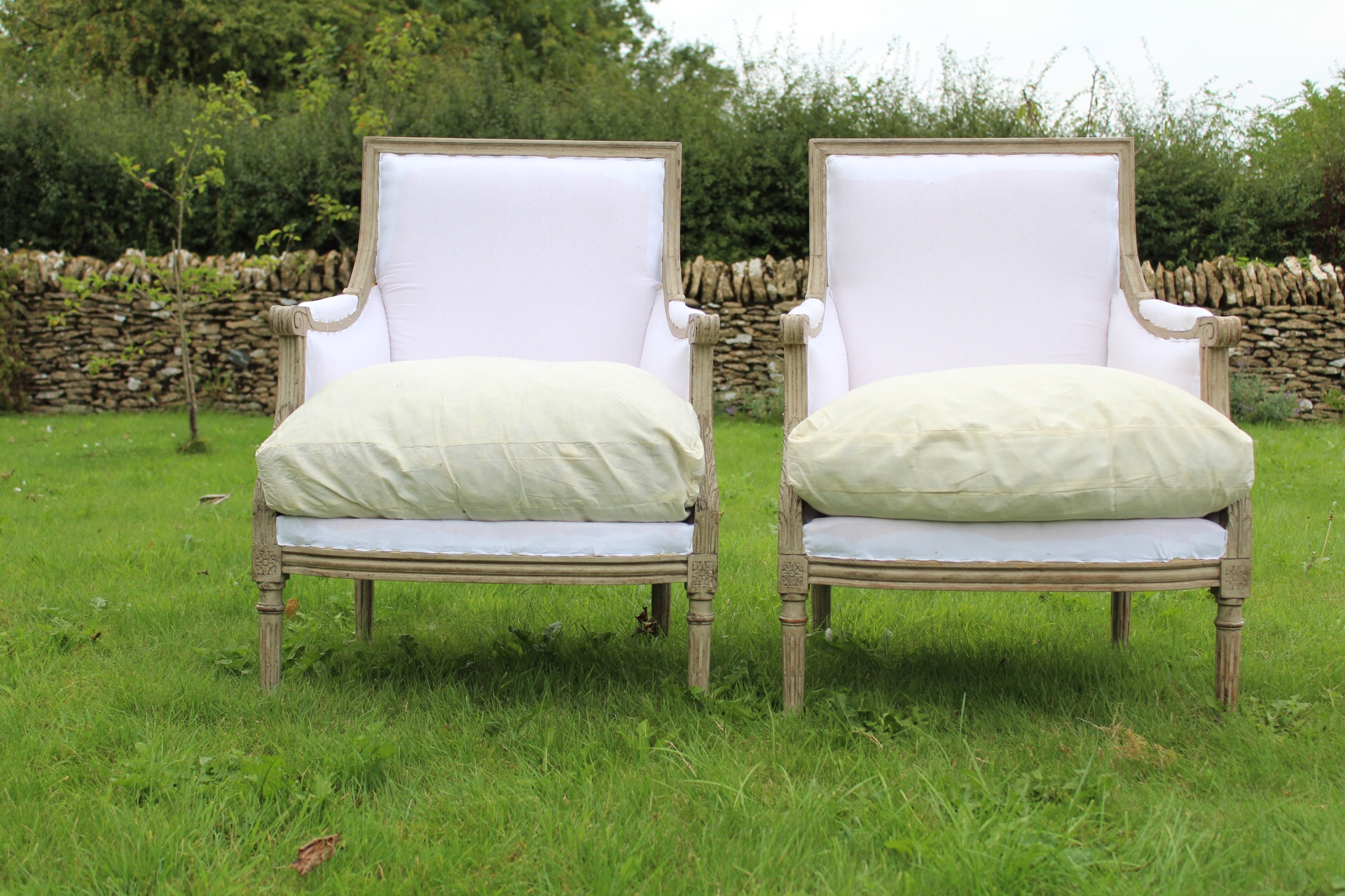 A pair of Swedish vintage armchairs , in calico