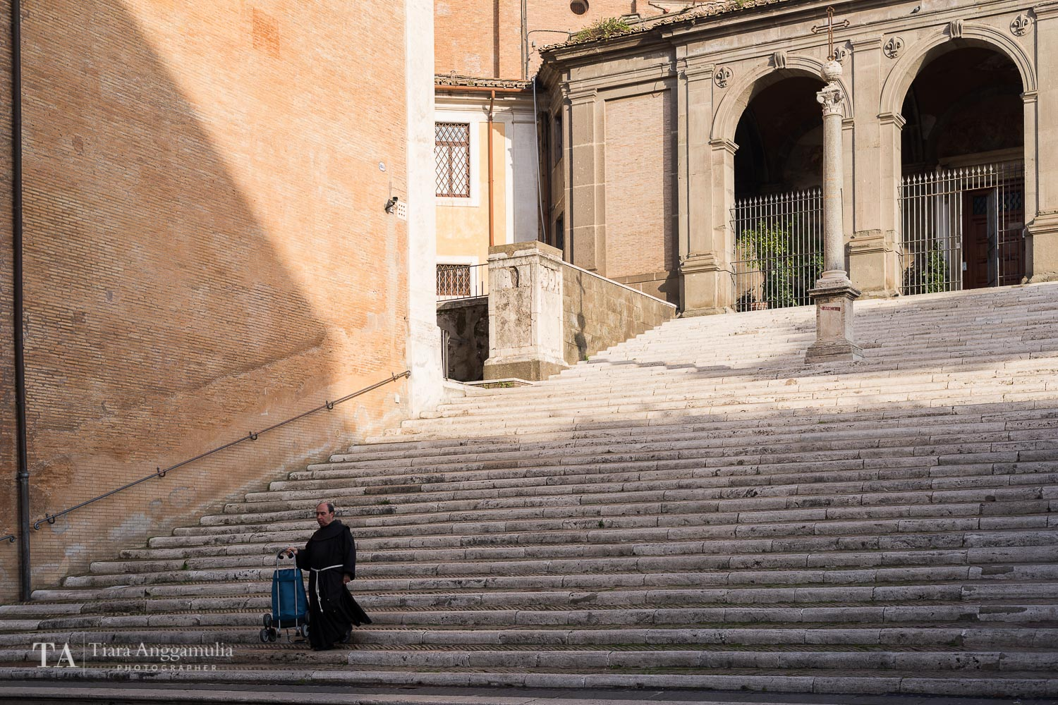 Monk coming down the steps at Capitoline Hill.