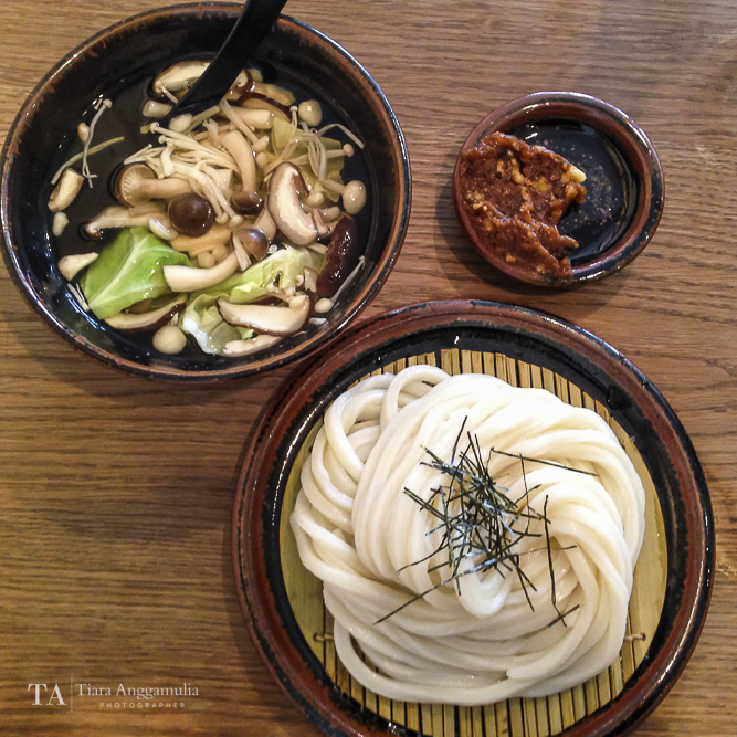 A delicious Japanese lunch of cold udon, hot broth with mushrooms and walnut.