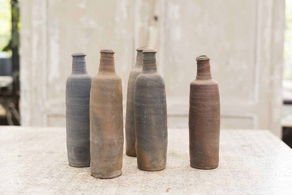 Assorted ceramic bottles inside Petersham Nurseries shop.