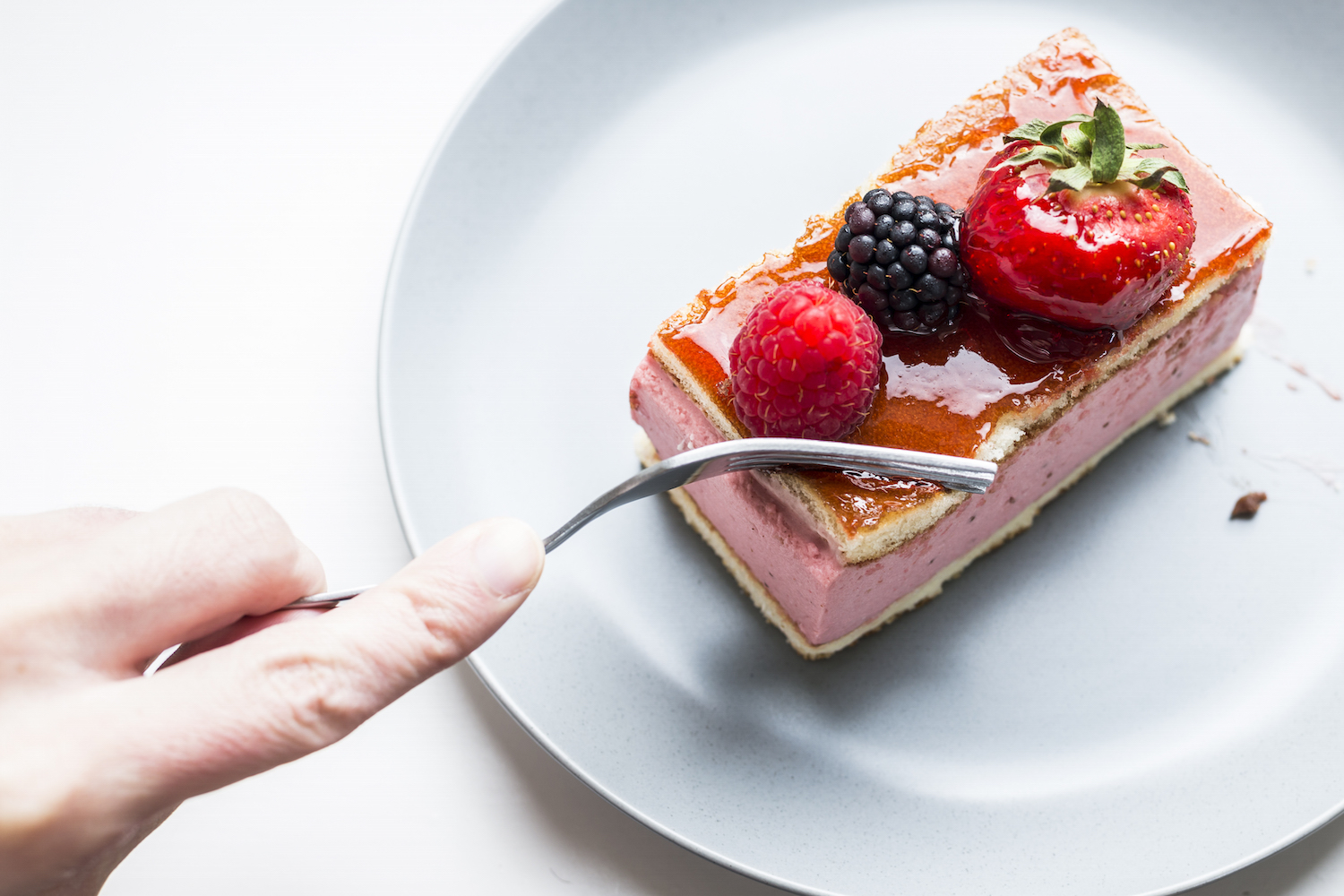 Cutting a mixed berry mousse cake.jpg