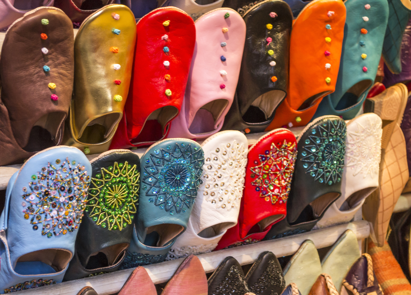 Colourful slippers on display in a Marrakech market stall.jpg