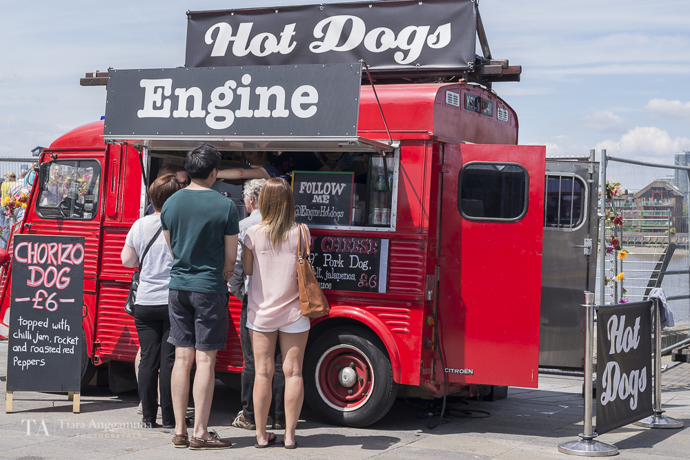 Queuing for hot dogs on a summer day.