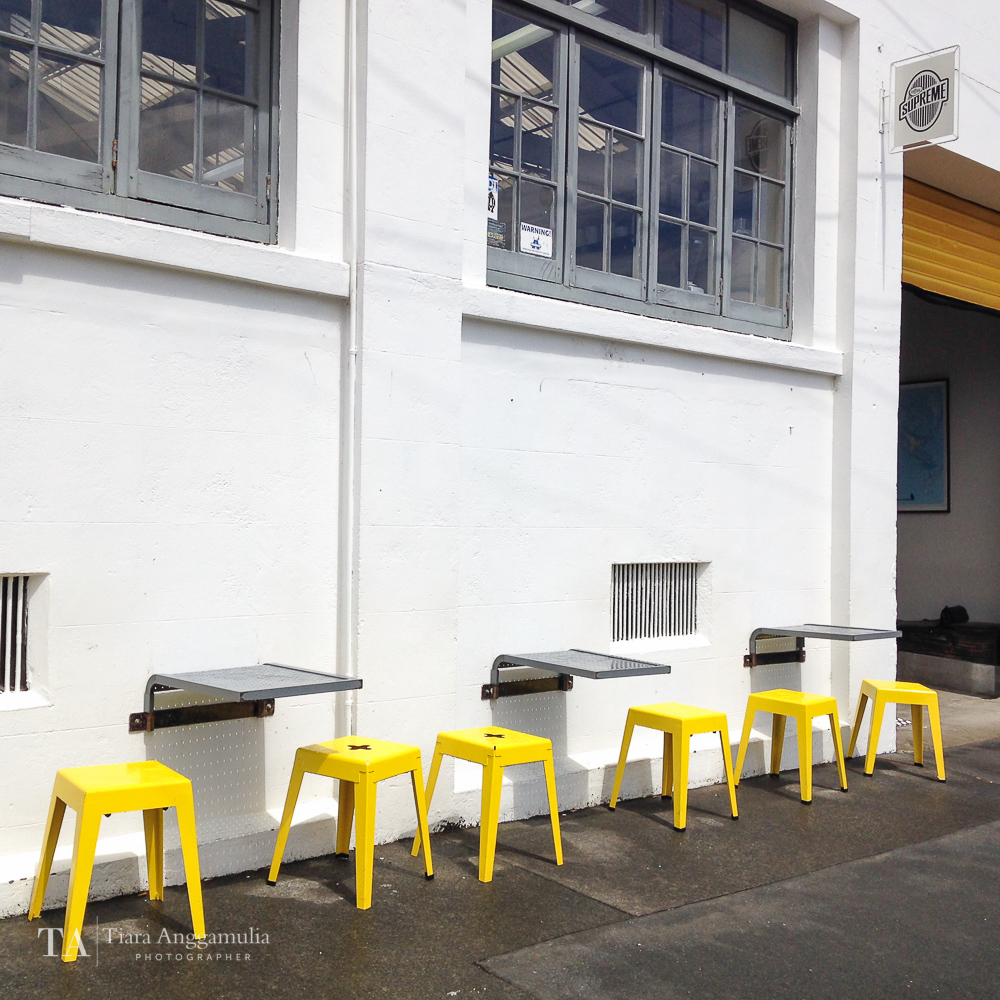 Yellow chairs outside the Good One coffee shop.