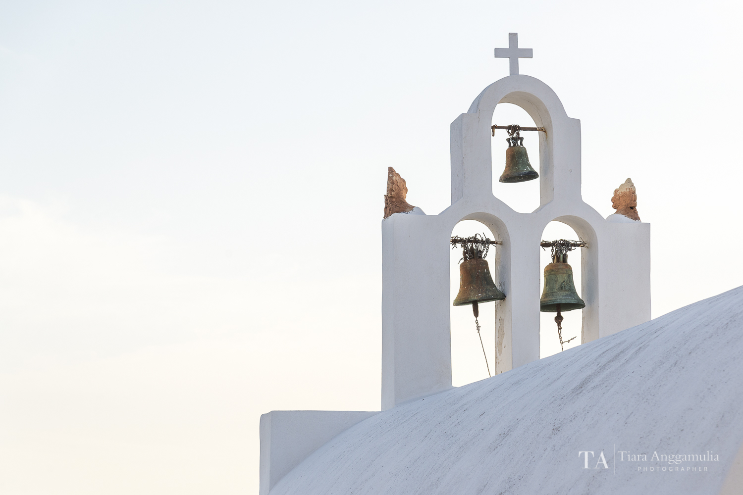 A view towards the bells on top of a church.