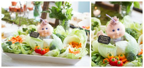 Kelly's masterpiece! When we first decided to co-host Hollie's shower together, we bounced ideas off of each other. This was the only one she insisted on doing...& I completely agreed. How hilarious? I just got a big tray of veggies from Costco & a few heads of cabbage. We lined a big tray with the cabbage and then filled the veggies in. Cabbage patch baby was wrapped at the base in plastic wrap to avoid getting dirty. A super easy display for any themed baby shower!