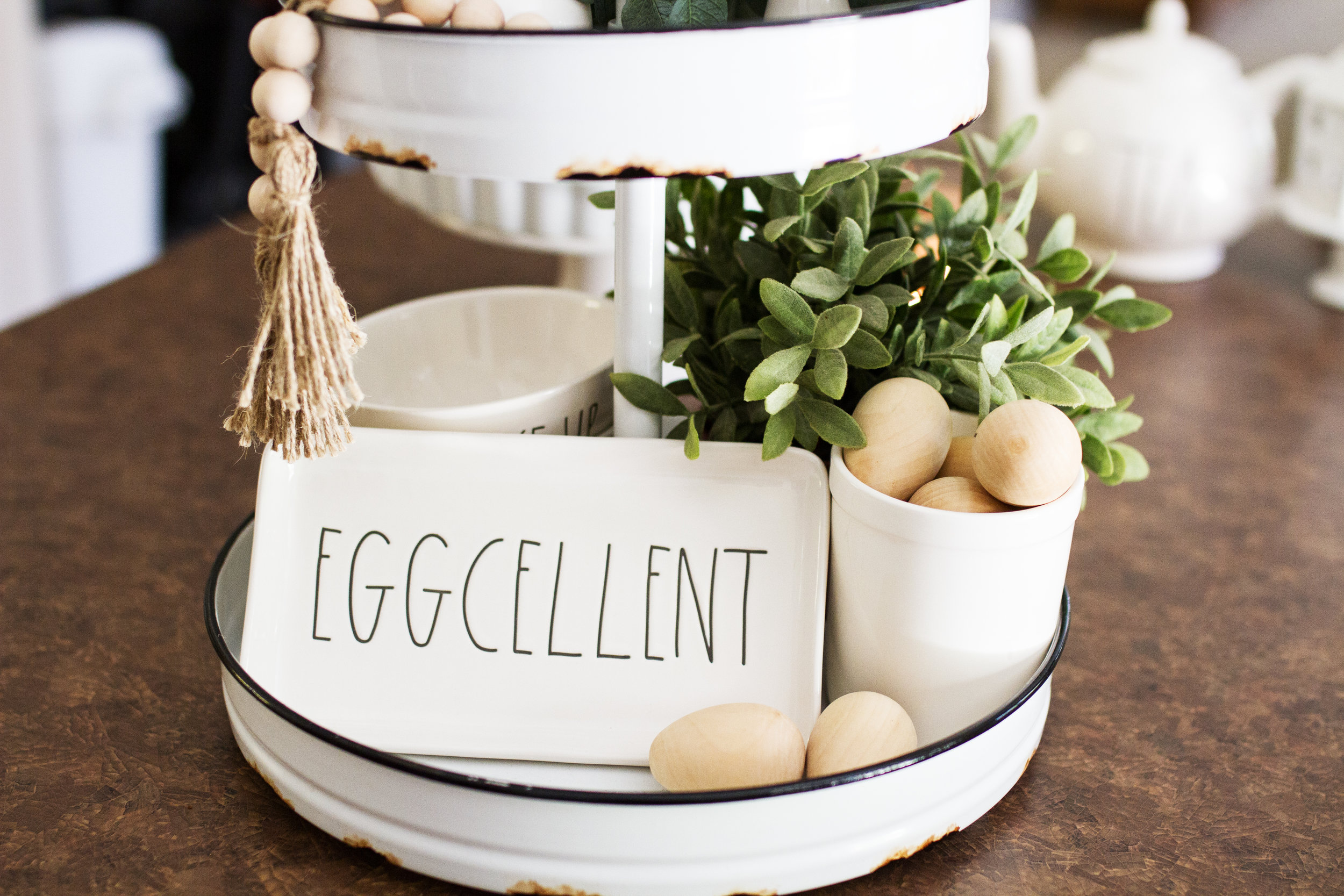 White Tiered Tray: Hobby Lobby   EGGCELLENT plate: Rae Dunn, Home Goods   Wooden Eggs: Target Dollar spot  Faux plants: Ikea