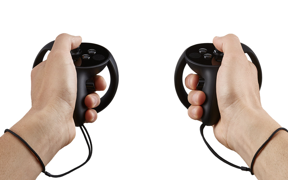 I tried the Oculus Touch controllers. They aren't released yet, but they're looking and feeling pretty darned cool.
