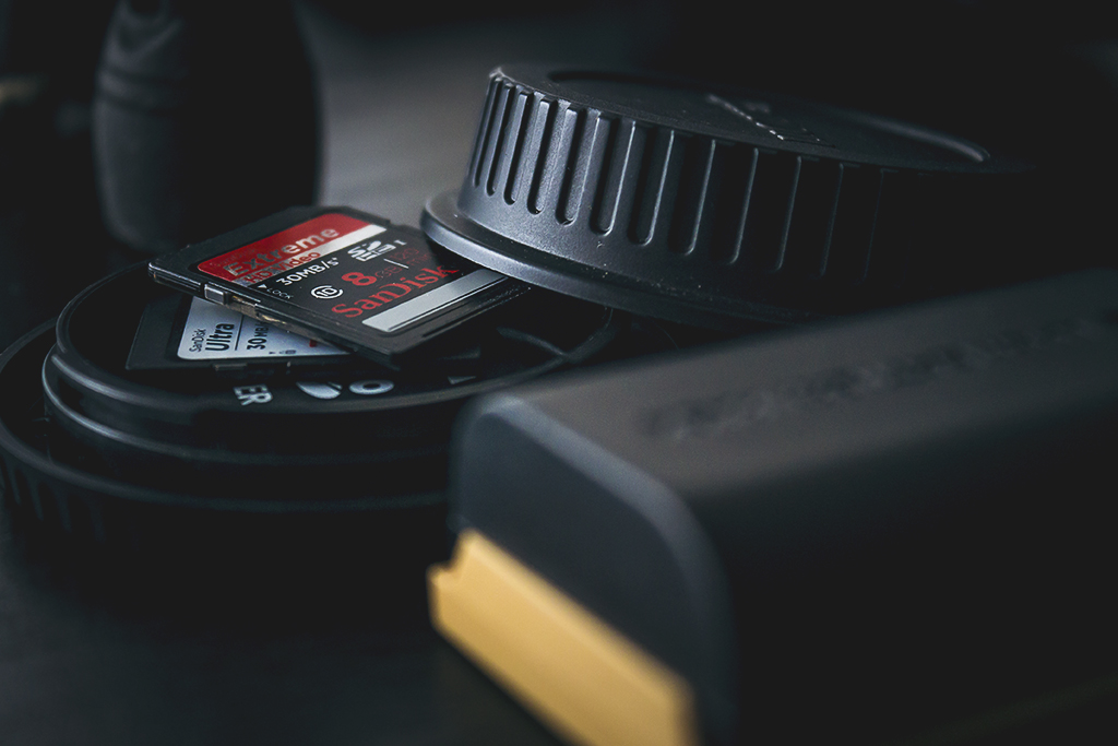 Free some space and store spare memory cards inside your body/lens caps.