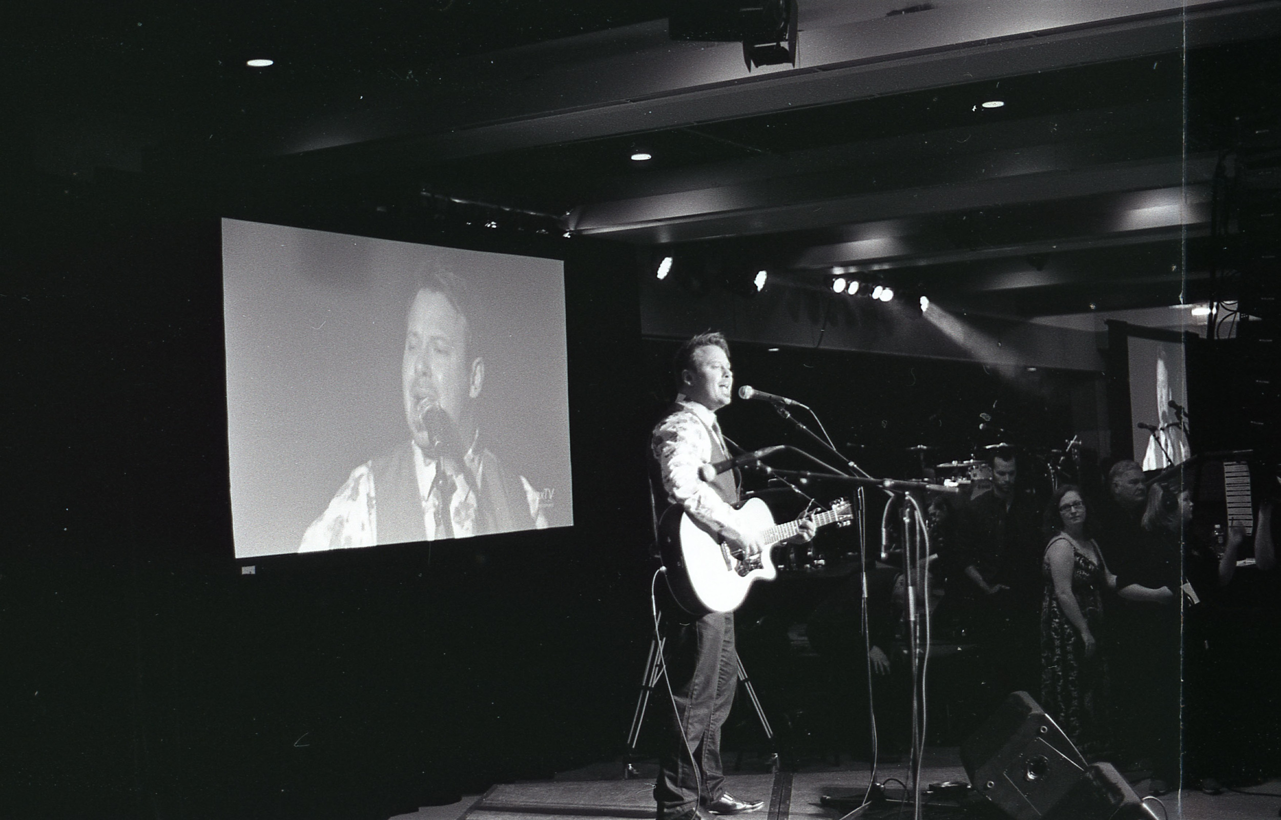 Alex Runions on-stage performing a song and taking home two SCMA awards. | Pentax K1000 / Kodak Tri-X @ 1600
