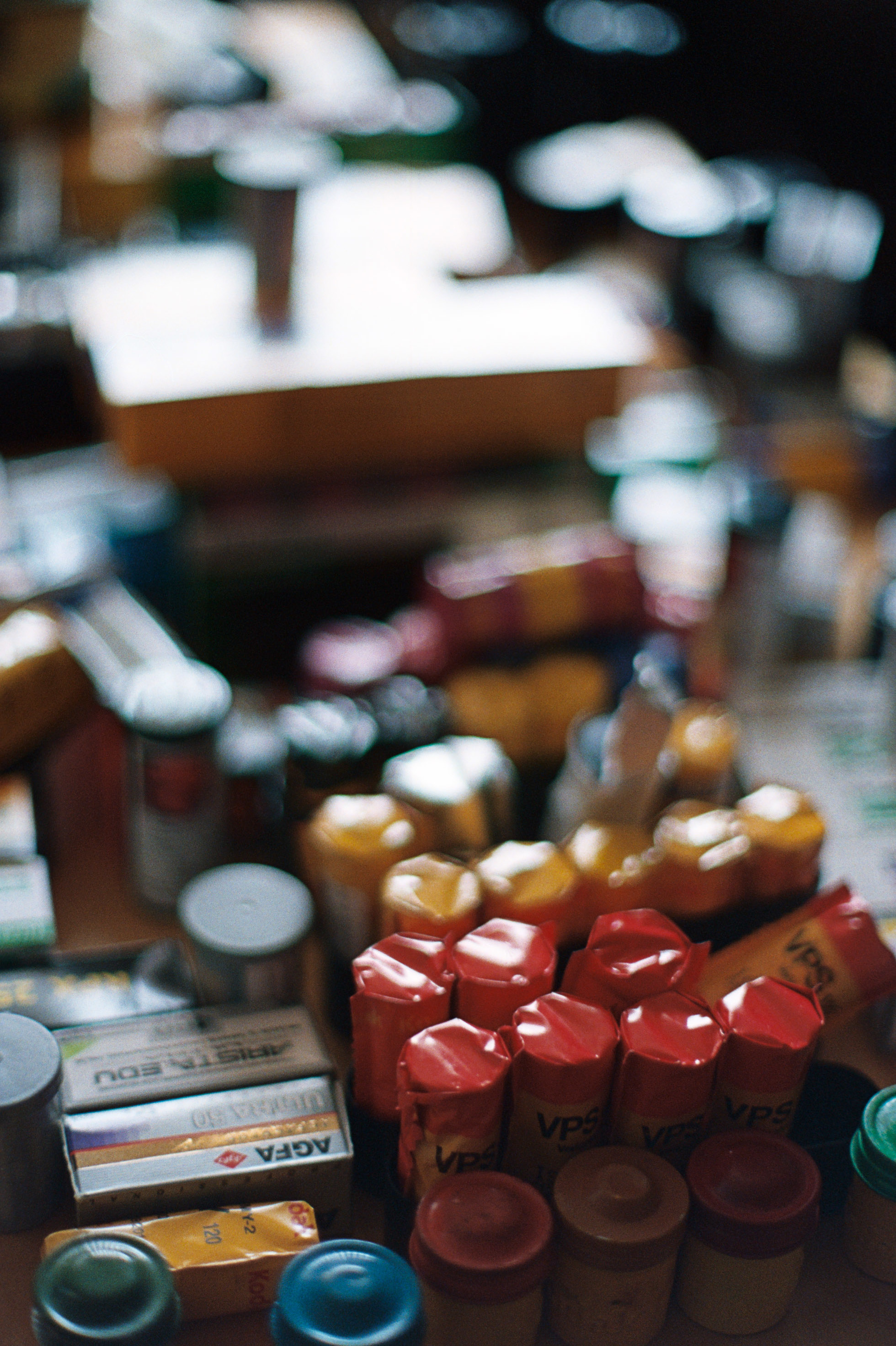Coffee table stacked with various film stocks - heaven!  Nikon FM3A + Nikkor 50/1.2   Lomography Color 800
