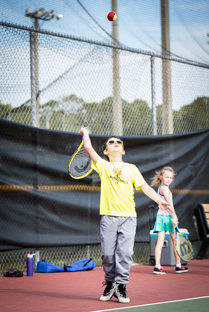 Ryan's overhead serve. - Photo credit Mariela Mcsoley Photography