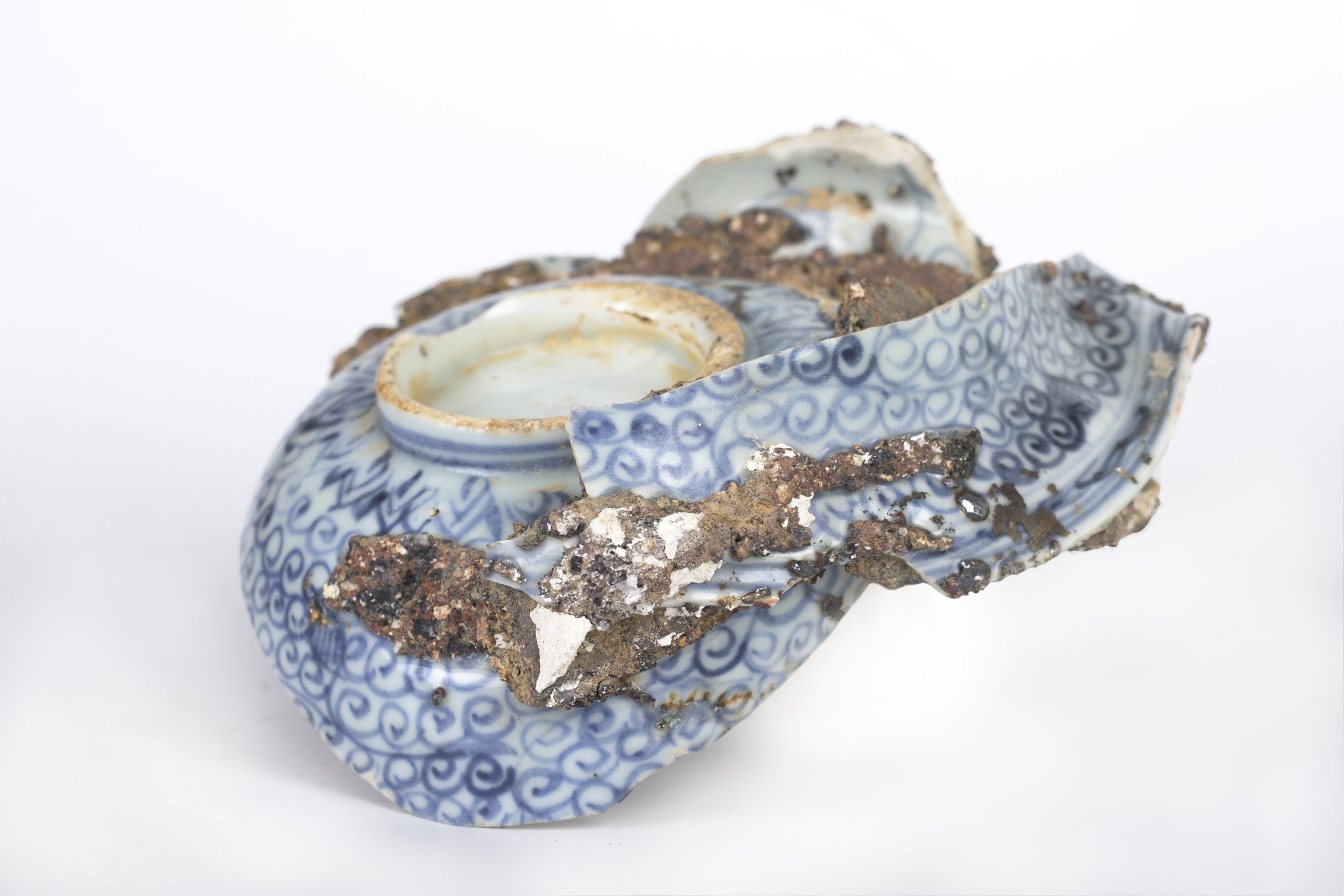 Saggar | Form Series , Found Ming Dynasty Saggar and Porcelain. 2017 - on going  Ming Dynasty collapsed saggar and porcelain forms were collected from various sites around Jingdezhen, China, and moved through the mold making process; cast as thin porcelain versions of their former selves. Shifting form to surface, these objects touch lightly towards ideas related to dislocation, longing, and the inescapable potential of the cast off. Collapsing time and place, their glazed interiors seek to reanimate the objects as functional vessels of the present.