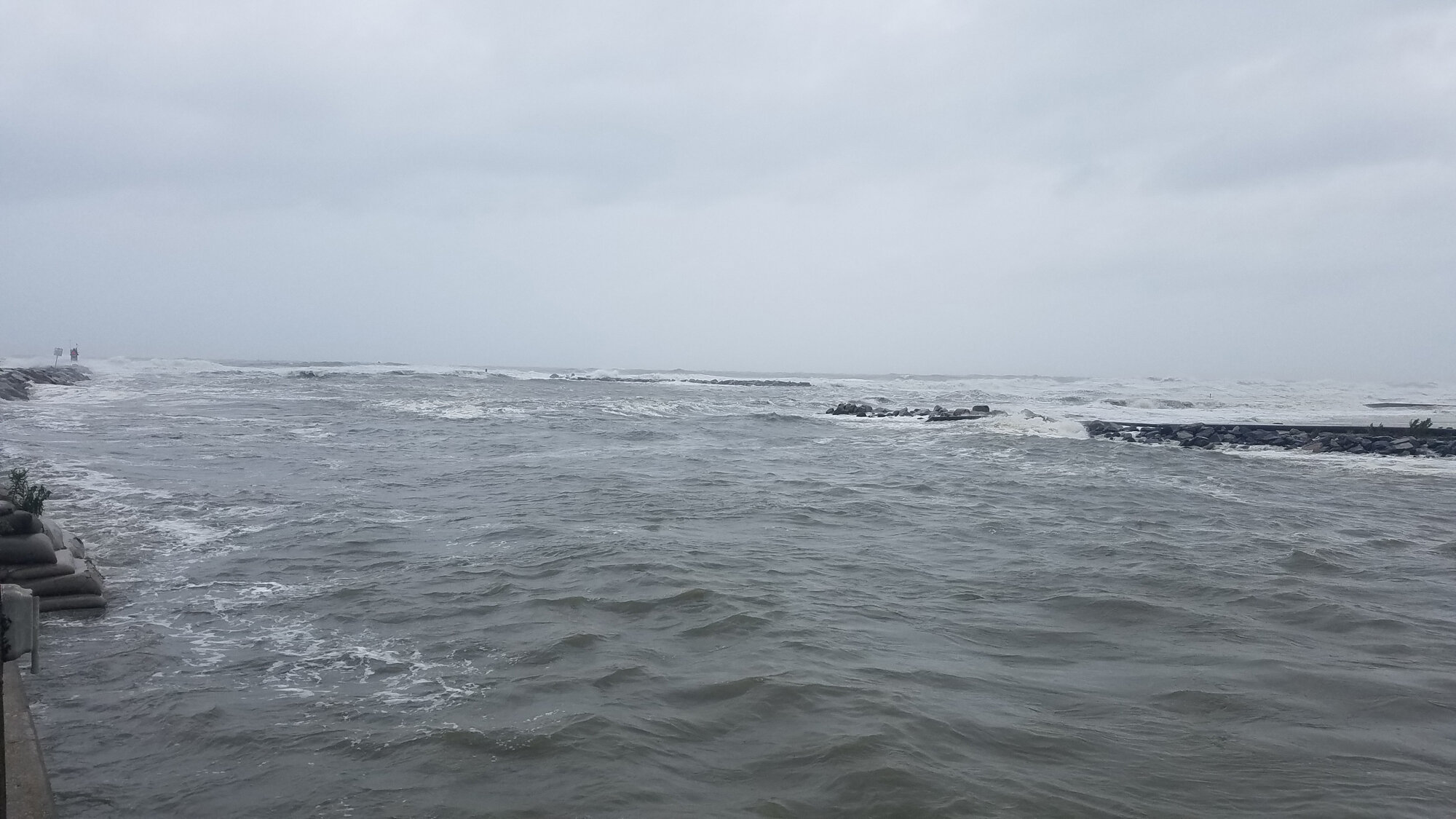 Rudee Inlet on 6 Sep, during the height of Hurricane Dorian's passage, with the offshore jetty barely visible at high tide.