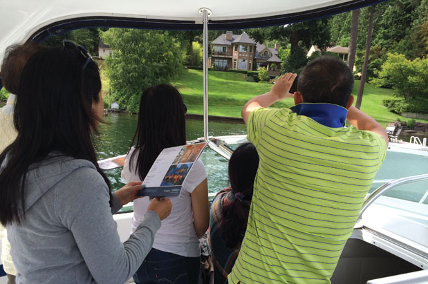 "PICTURED ABOVE:   Cunningham used Dean Jones's photo in the article, writing that ""  Realogics Sotheby's International Realty reports a significant increase in Lake Washington waterfront tours with Asian homebuyers. Here, a family from mainland China explores a Hunts Point listing offered at $8.75 million."""