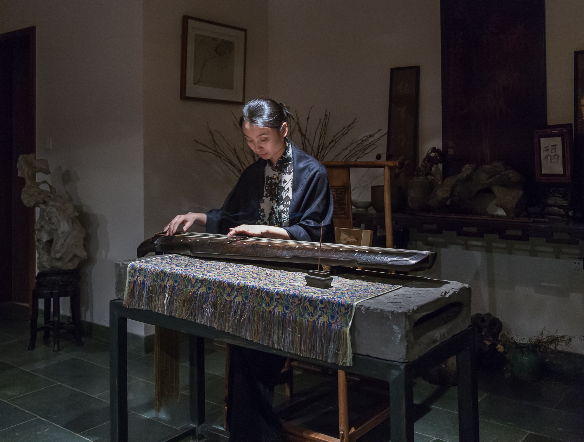Musician with an ancient instrument, Suzhou, China