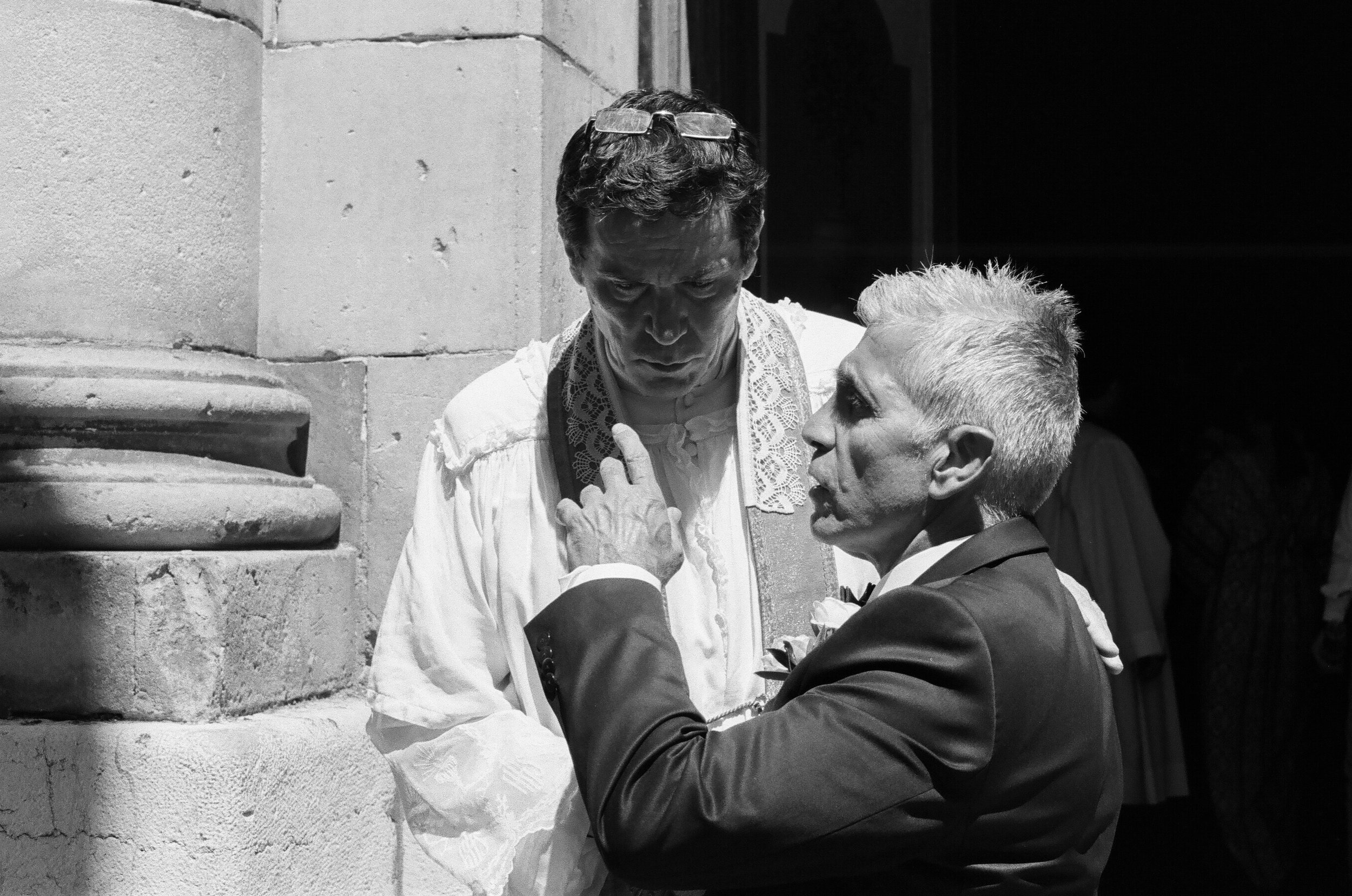 A priest listens intently to the father of the bride, Port de Saint-Tropez - Clifford Darby 2017