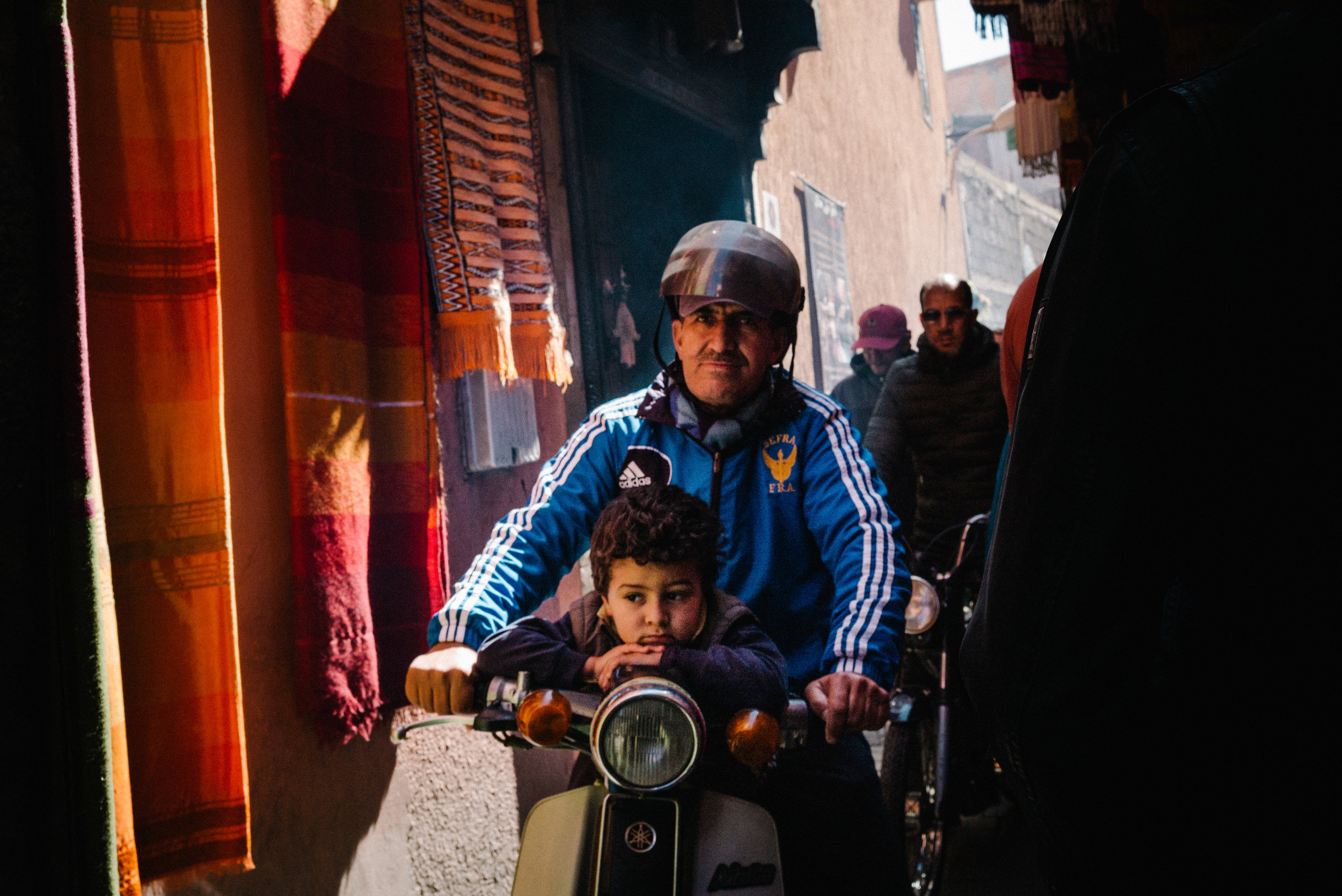 A father and son navigate the narrow streets of the medina - Clifford Darby 2018