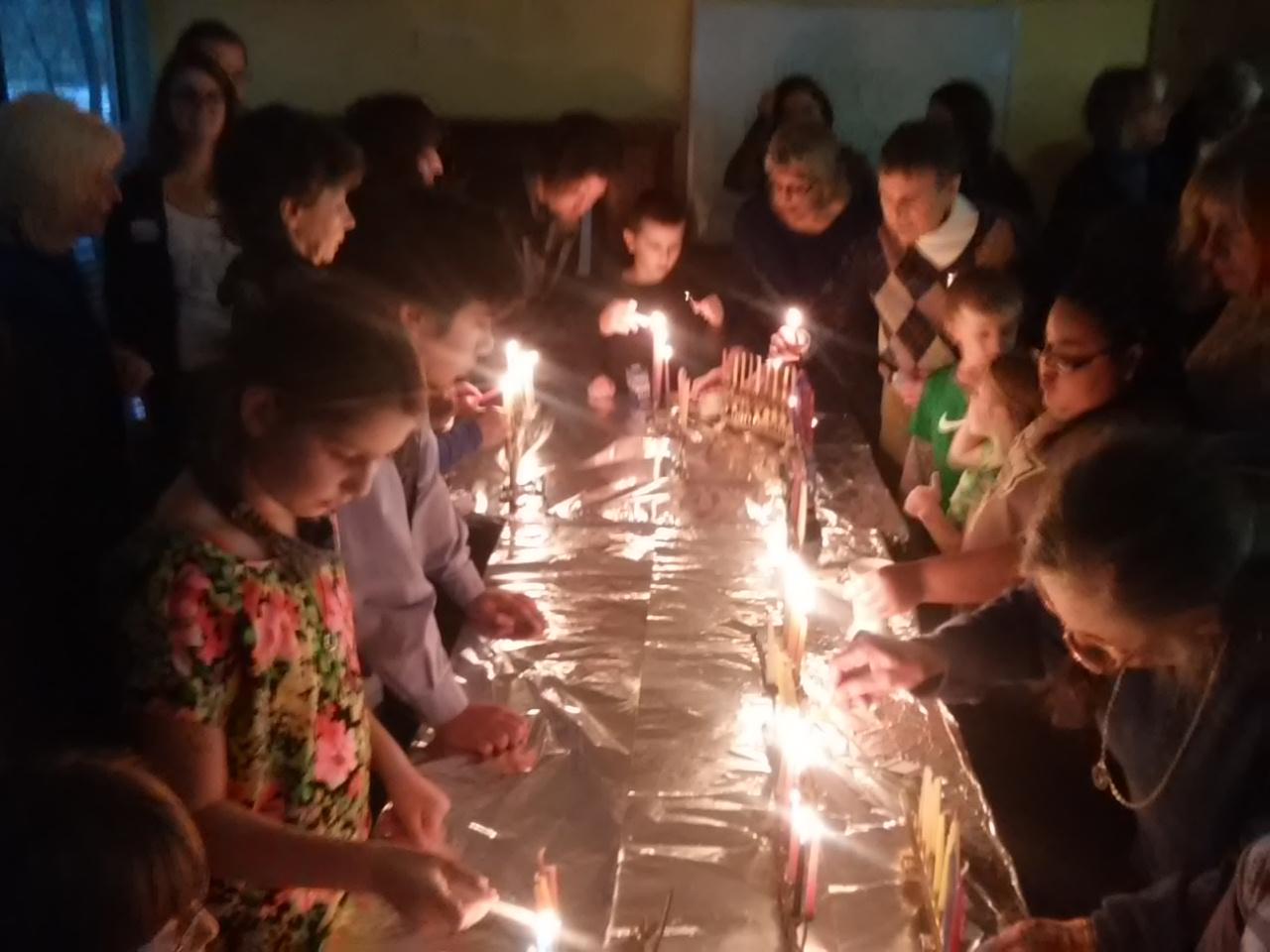 joint hanukkah menorah lighting