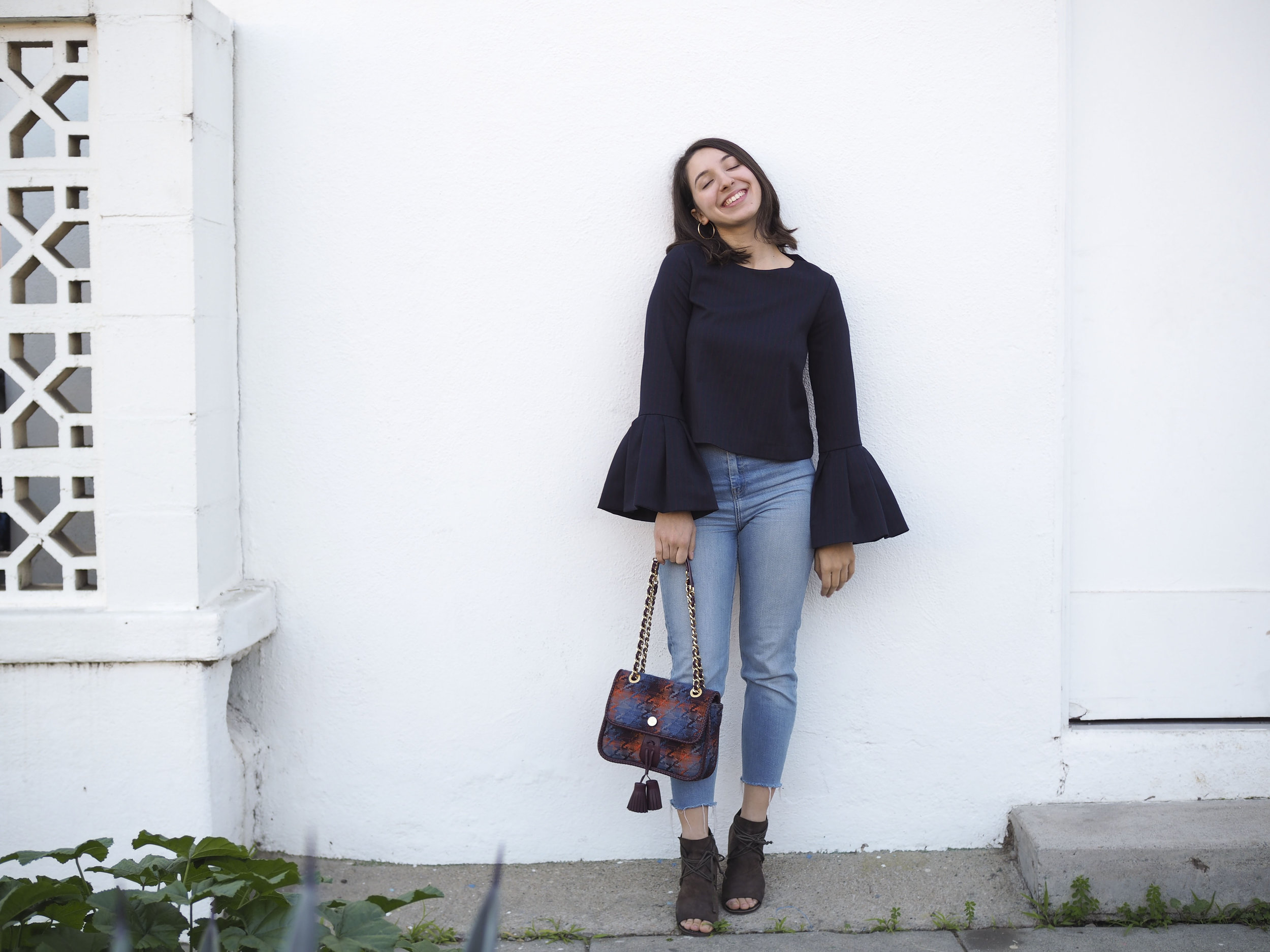 Zara Top, Top Shop Jeans, Vivienne Westwood Purse, Marsèll Shoes and Unknown Earrings.