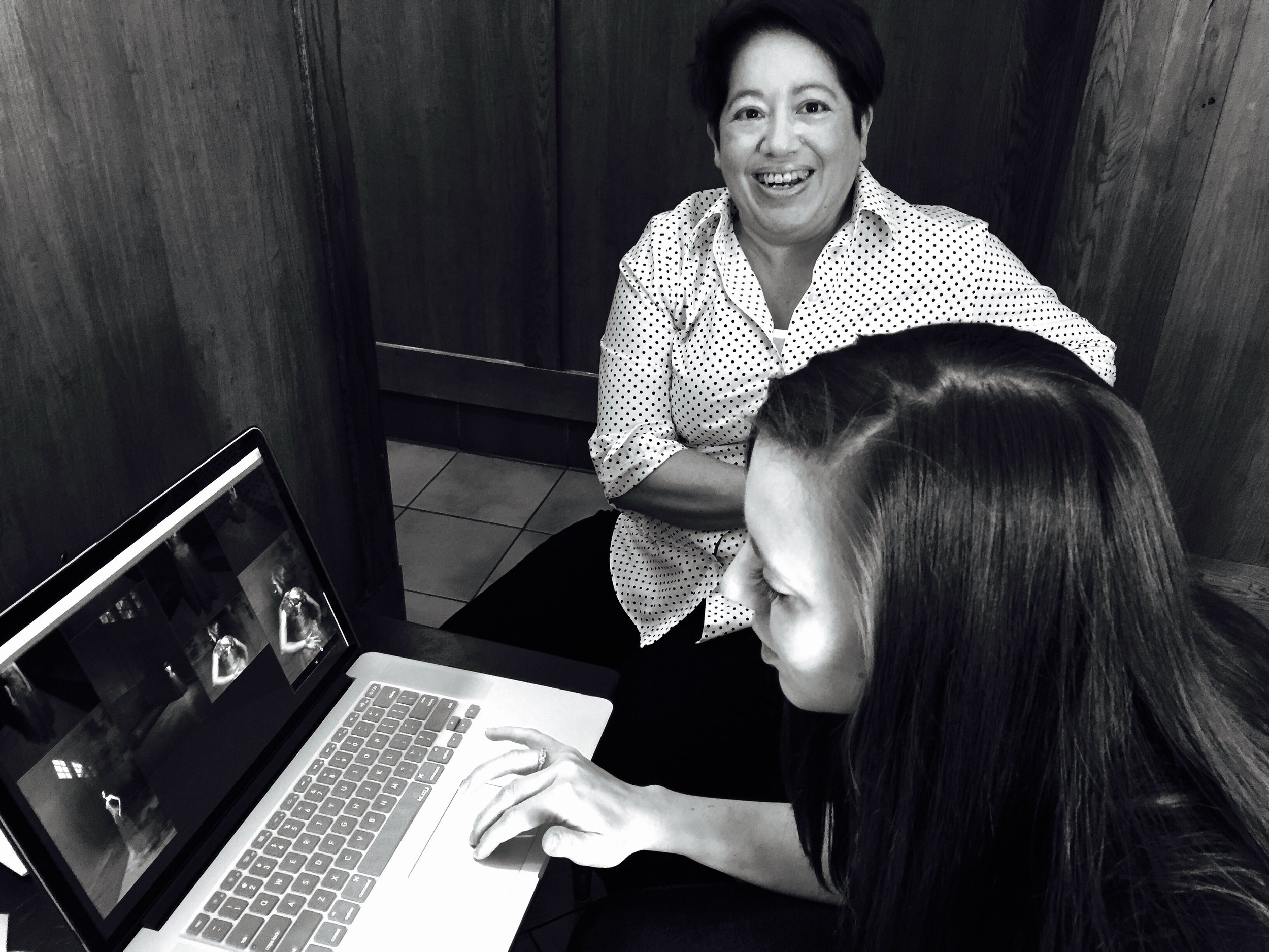 Here Kimberly Pimentel of Pimentel Portfolio shows Amy Stegman her images.