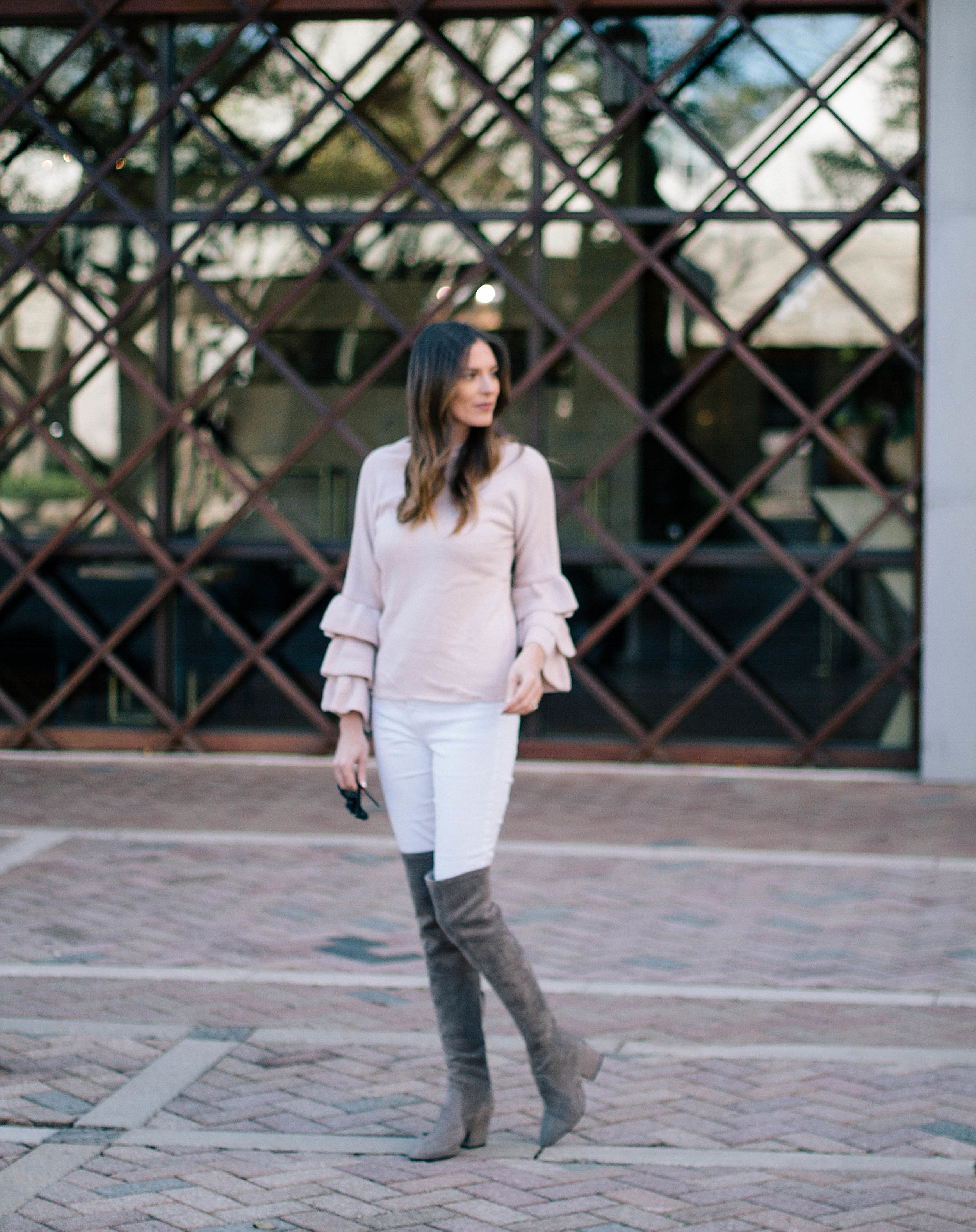 Pink ruffle sweater and OTK boots