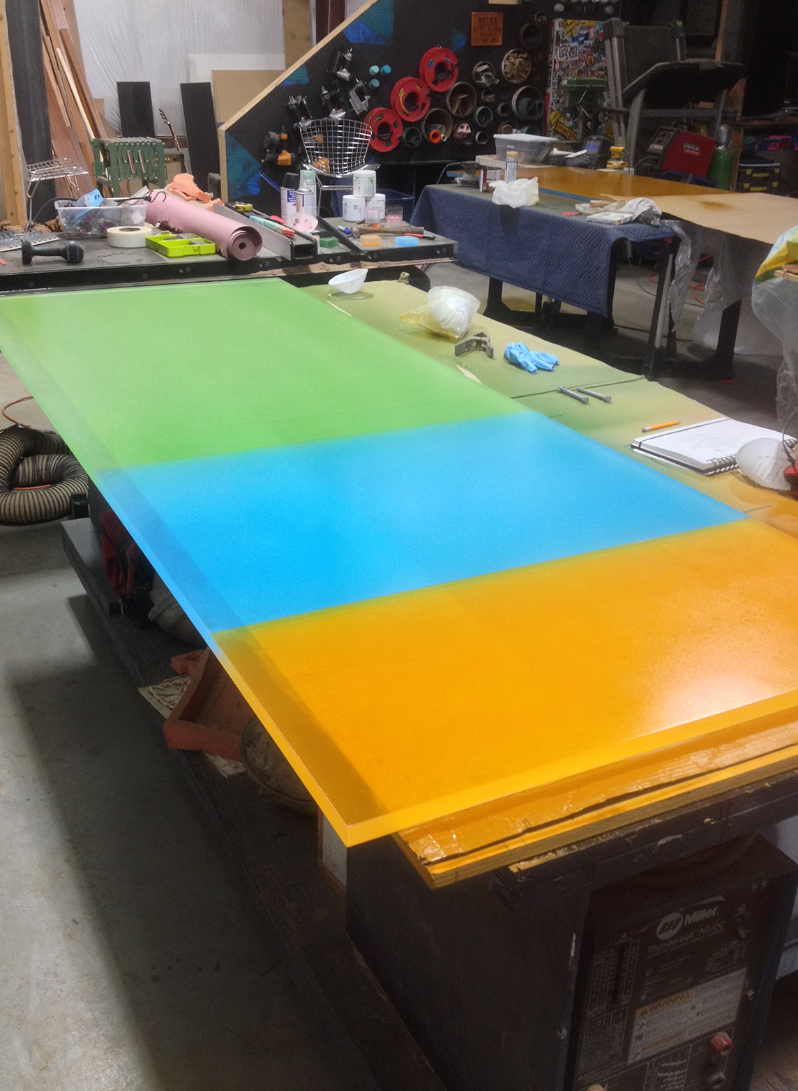 The conference was four colors in total, matched from Pantone and arranged in various sizes. These three were sprayed on a single section of 1'' thick plexiglass.
