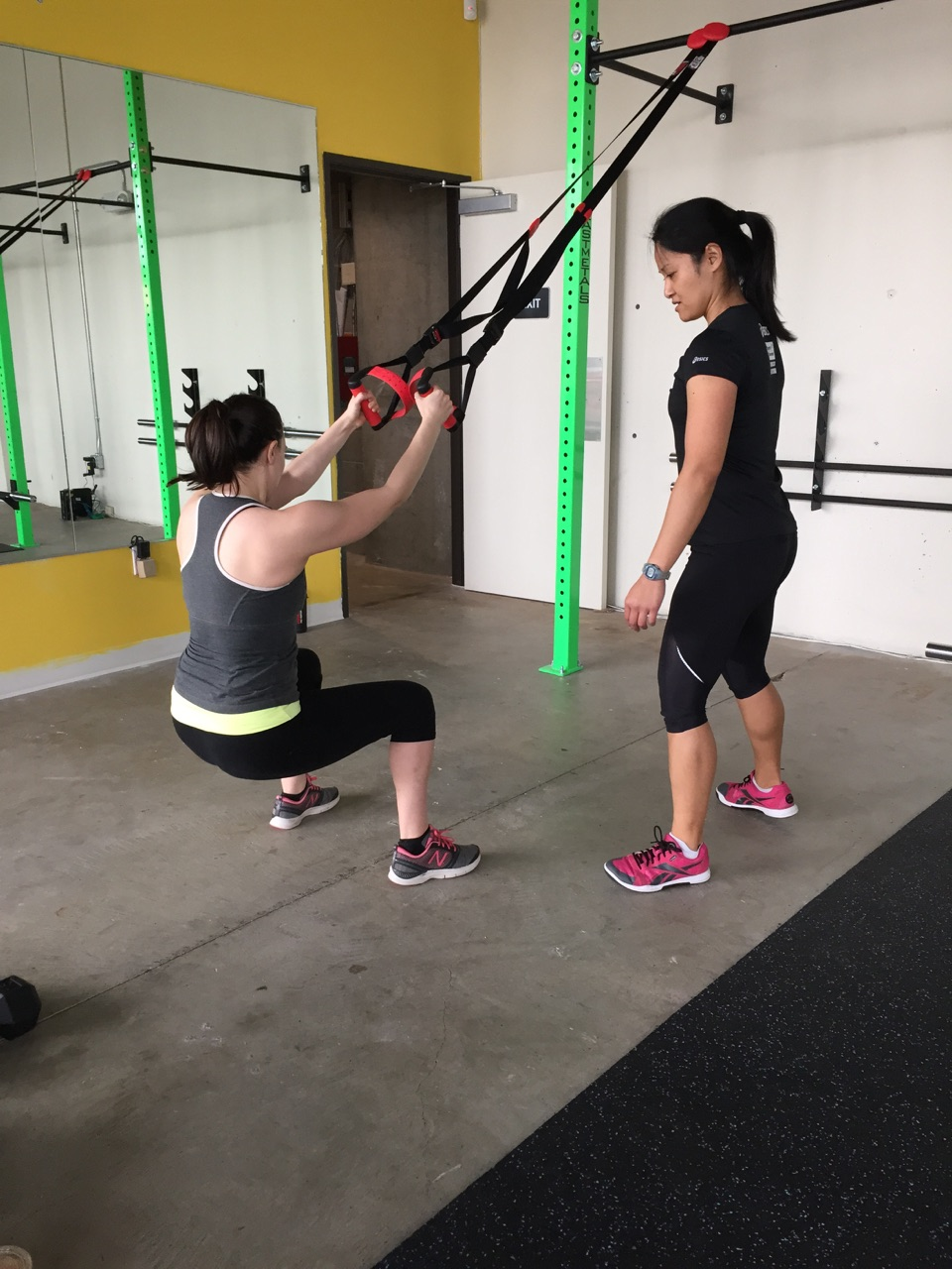 Working on TRX squats with my client.