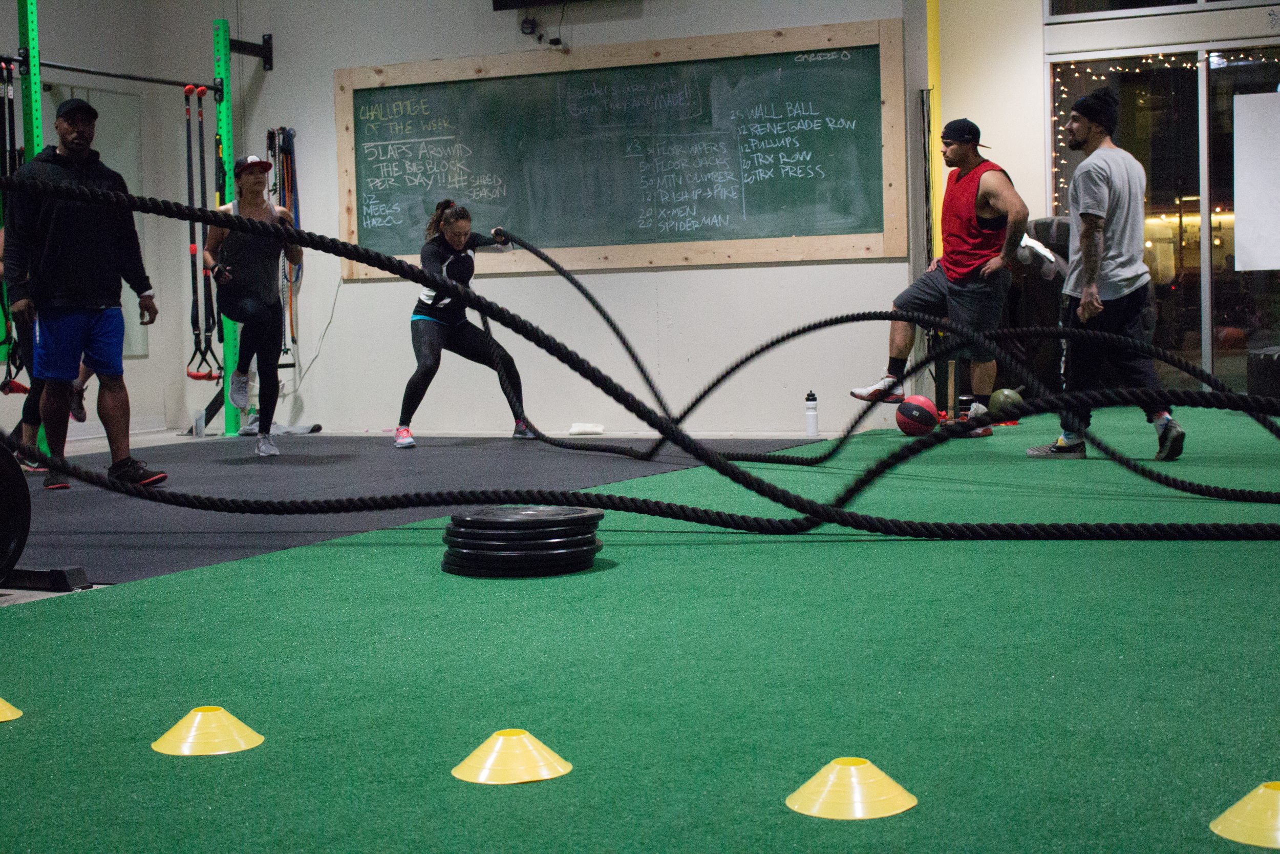 Evening class hitting the battle ropes.