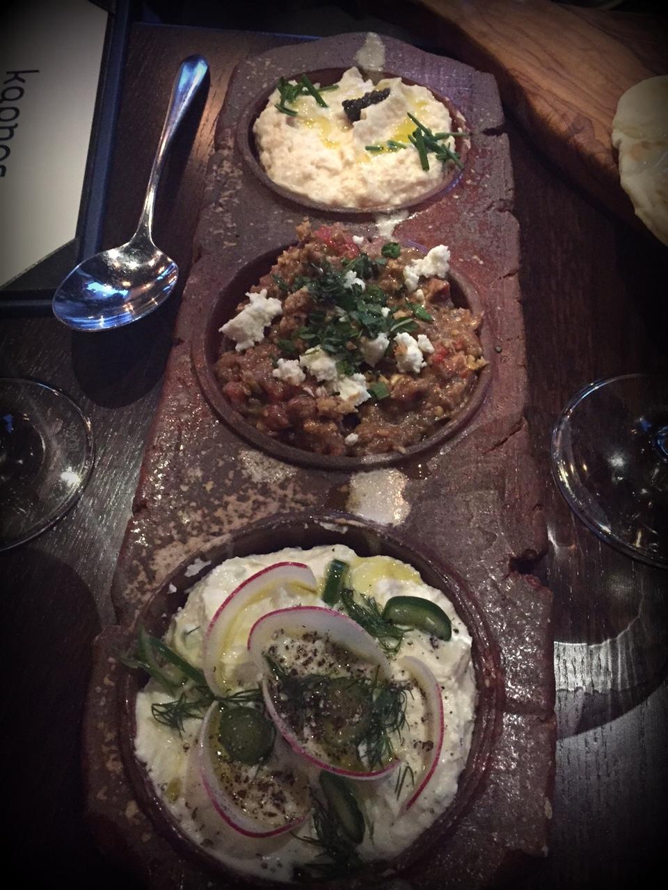 3 spreads: taramasalata made with carp roe, caviar and cauliflower;melitzanosalata (smoky eggplant, walnuts, feta and roasted sweet peppers); andtyrokaftari (feta, manouri, and grains of paradise)