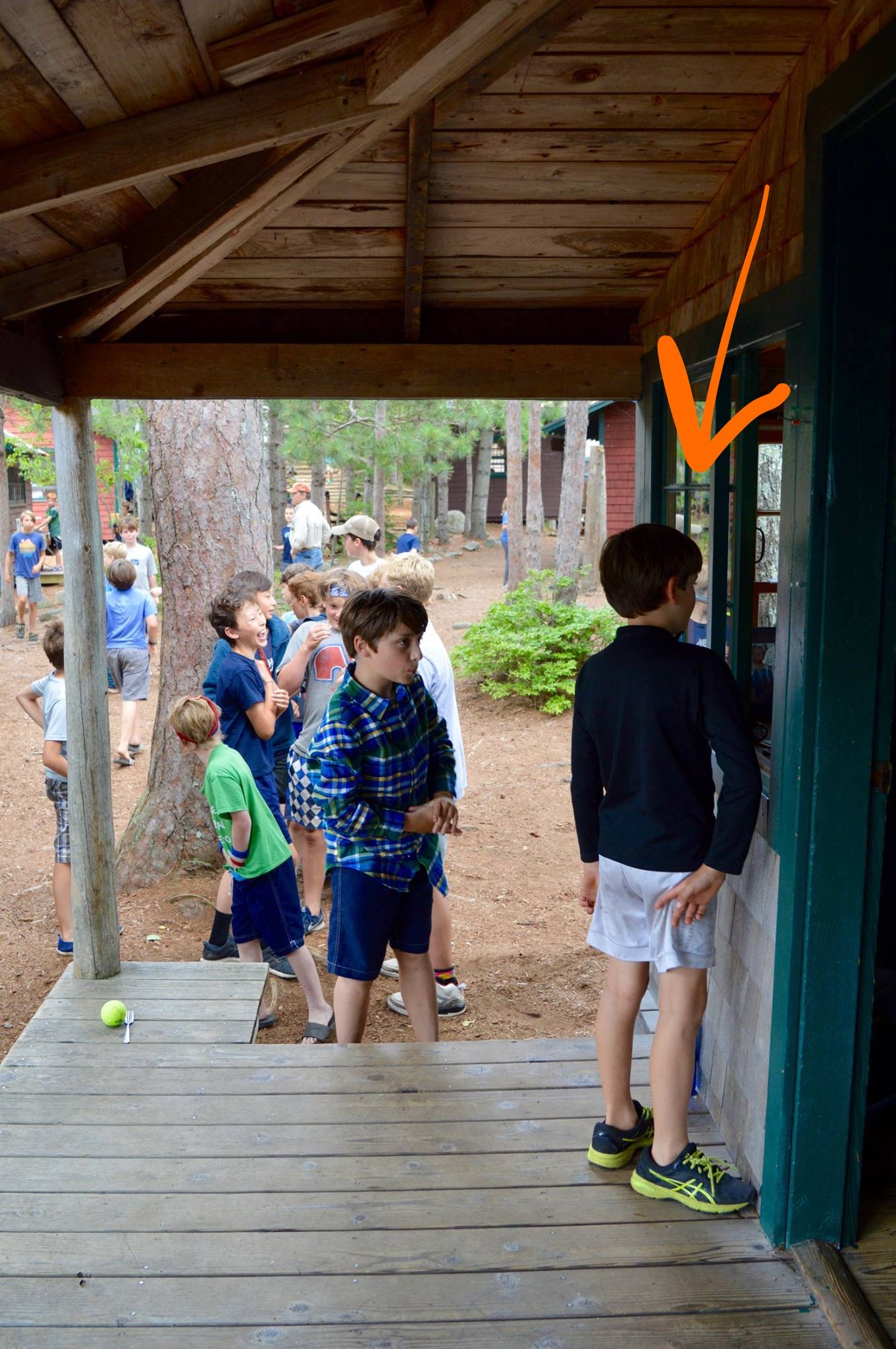 OMG, how precious are his legs?! The kids are in line signing up for War Game team preference.