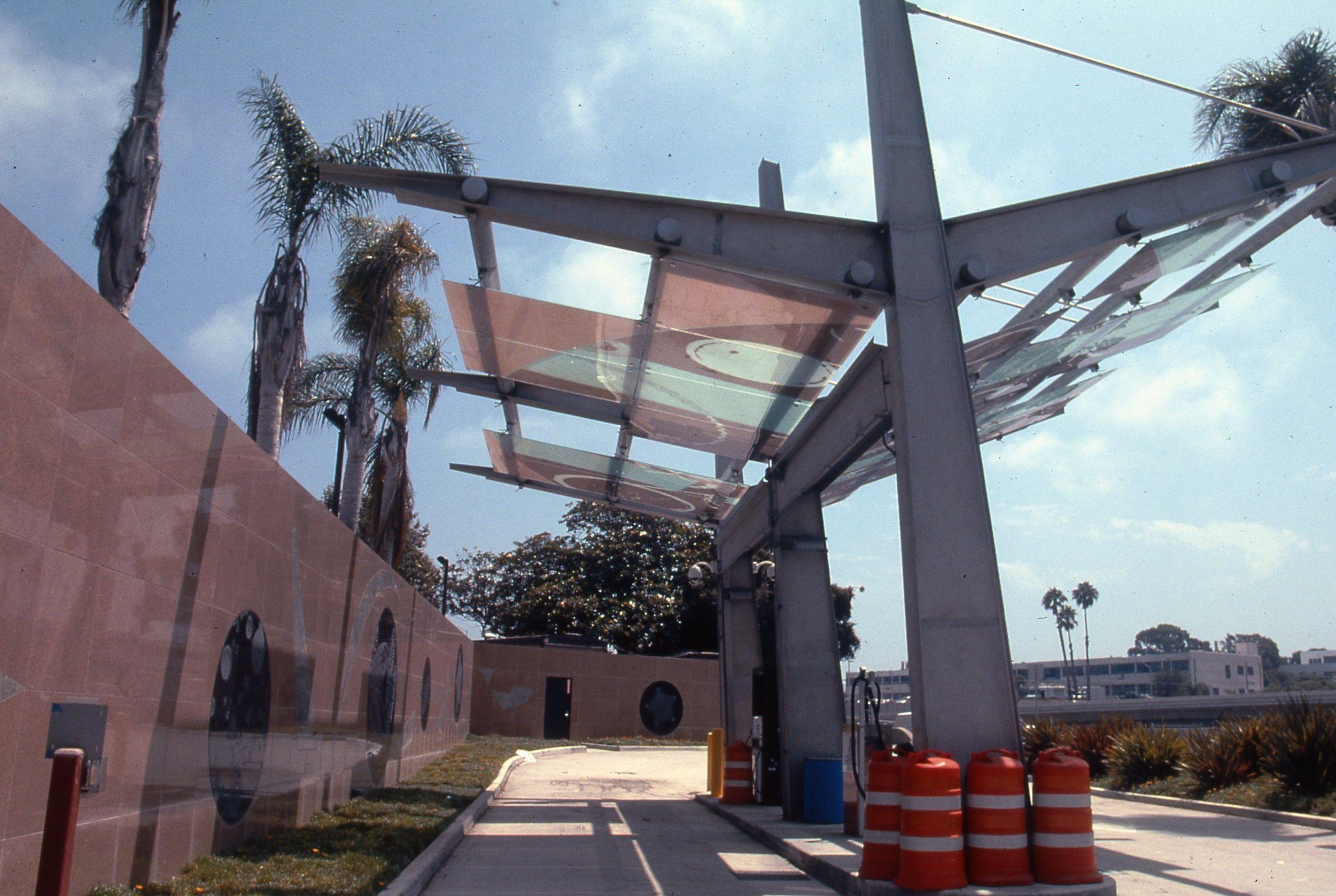 """Big Blue Bus Facility Expansion Project""    2002 - 2005 Glass canopy design and etchedgranite artwork   © Richard Wyatt Jr."