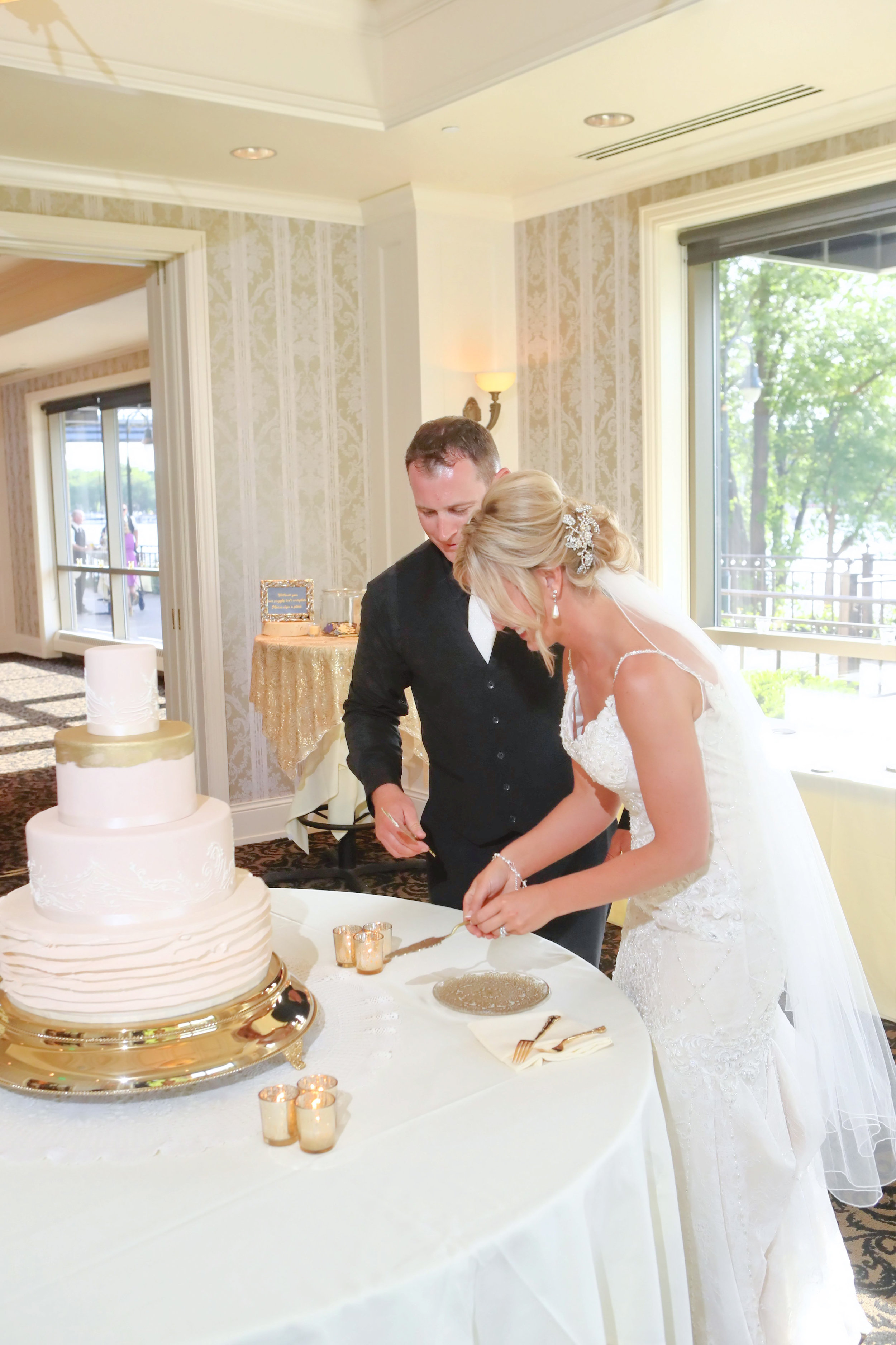 Ivory and Gold Cake Cutting at The Waterfront Cargill Room in La Crosse, WI