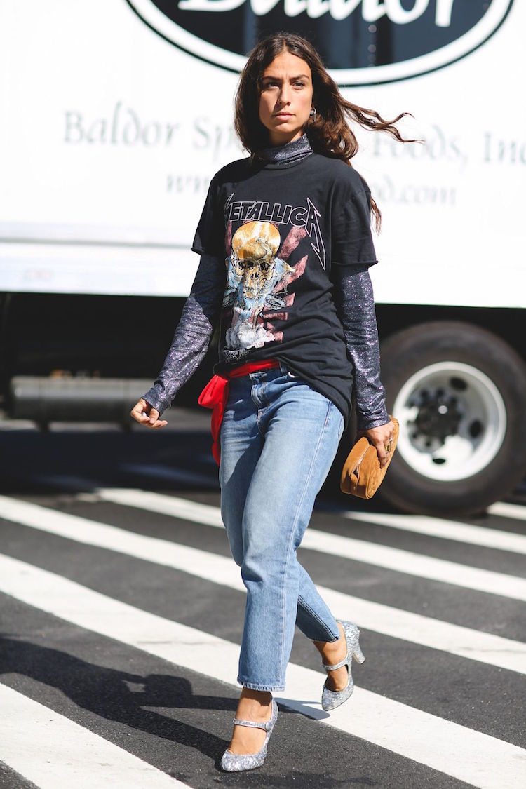 I adore the contrast between the rock n' roll edge of the top layering combination down to the glittery heel. The combination of a sparkly turtleneck and a glitzy heel can leave you feeling a little overly preppy, but I love the way this look is roughed up a bit with a band tee, loose jeans, and a casual suede clutch. The bright red belt scarf really sets the look off.