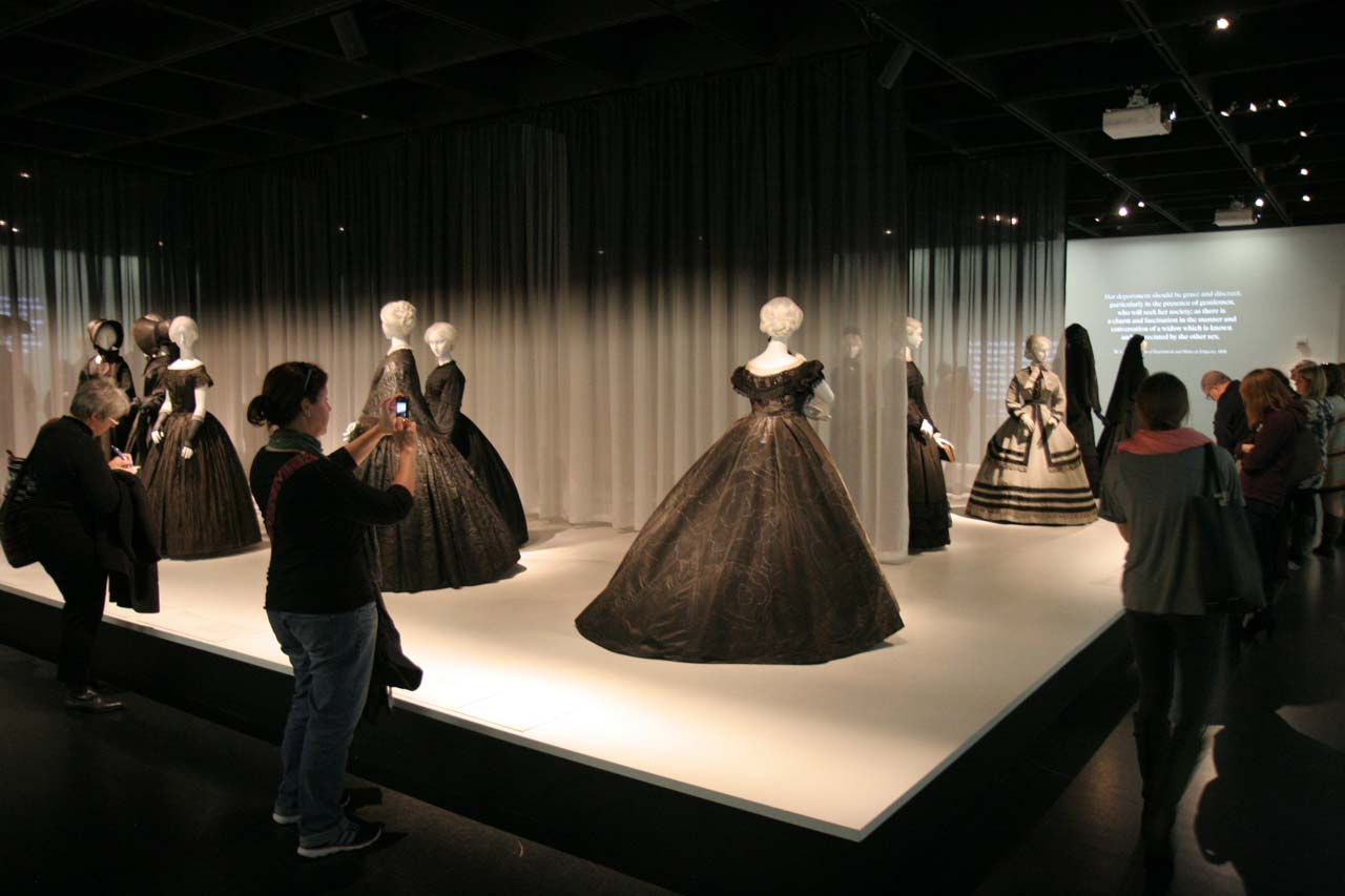 "INSTALLATION VIEW OF ""DEATH BECOMES HER: A CENTURY OF MOURNING ATTIRE,"" at the Metropolitan Museum of Art, Anna Wintour Costume Center. The exhibition followed the period from the 1830s to 1915, when average life expectancy was less than fifty and death in childbirth or as a child was common. The ensembles ranged from states of full-mourning to that of half-mourning. Photographs by Carolyn L. E. Benesh/Ornament."