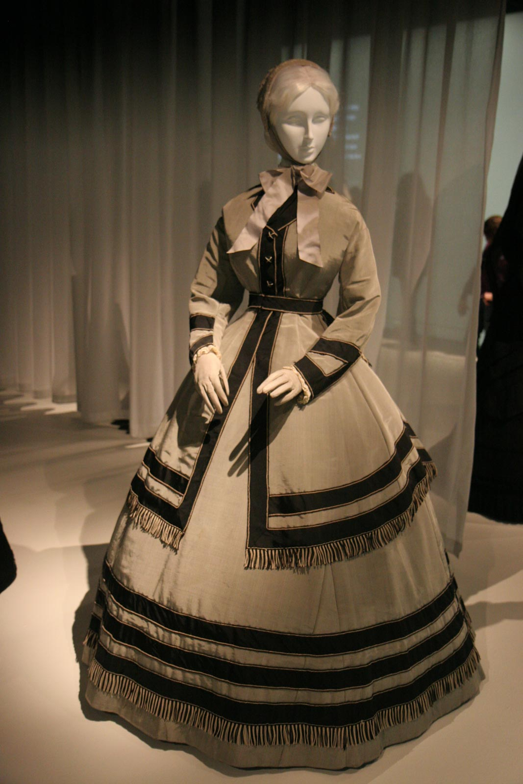 Gray silk wool poplin, black silk faille, black and white silk cording and fringe make up an American wedding ensemble from 1868.