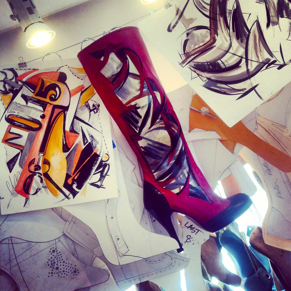 FIRST ATTEMPT OF TATLIN'S TOWER BOOT, handpainted and handmade, hanging among sketches.