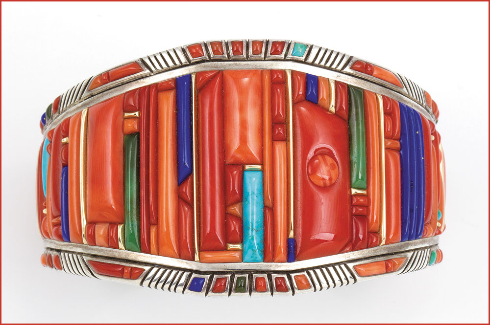 BRACELET by Raymond C. Yazzie of silver, coral, turquoise, lapis lazuli, fourteen karat gold, 6.03 x 2.54 centimeters, 2005.  Collection of Mark and Martha Alexander. Photograph by Michael S. Waddell. Photographs courtesy of the National Museum of the American Indian.