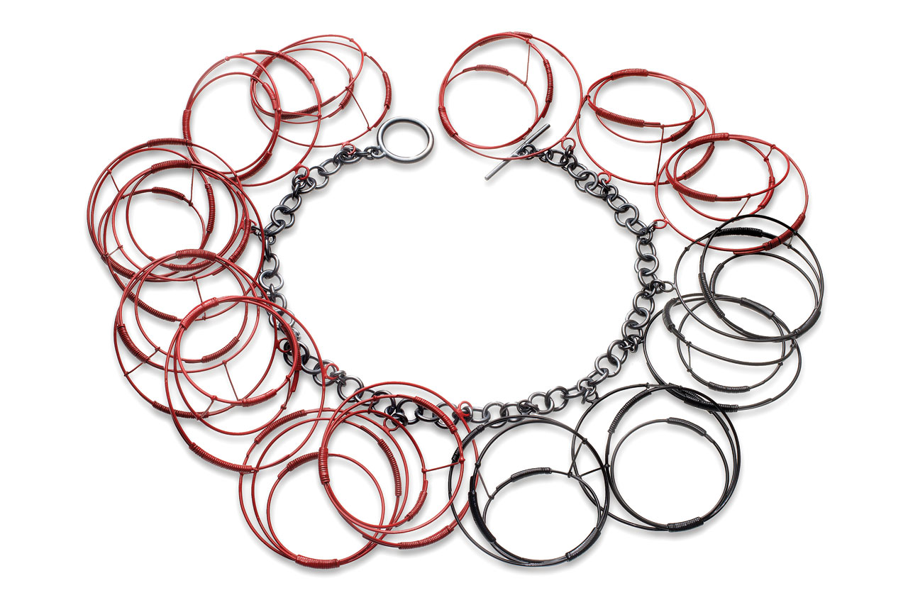 RED/BLACK CIRCLES NECKLACE of sterling silver, steel, powder-coated, hand-fabricated, 45.72 x 7.62 X 2.54 centimeters, 2012.