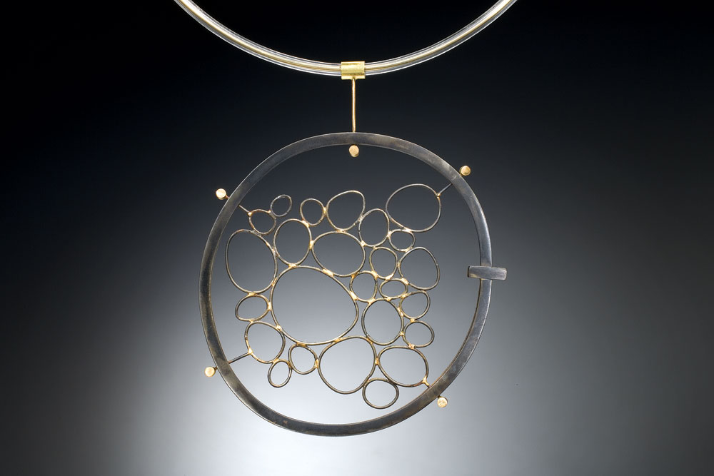 FORGED CIRCLES NECKLACE of steel, eighteen karat gold, PVC, forged, 10.16 x 9.53 x 1.27 centimeters, 2002.