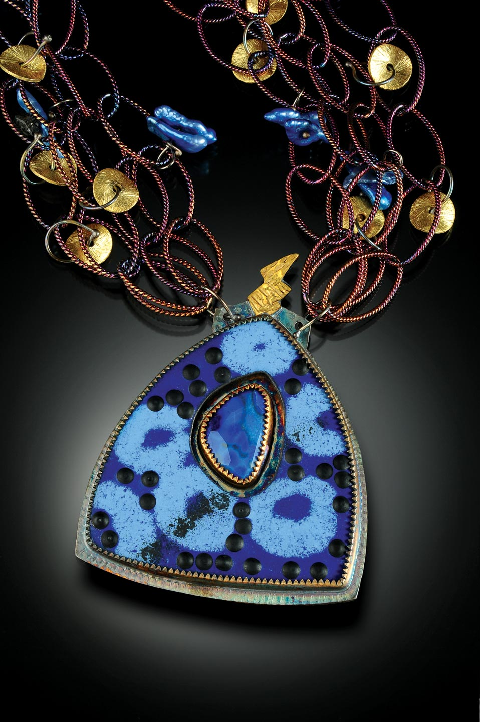 "NECKLACE of sterling silver, twenty-two karat gold, faceted lapis and enamel; pendant 3.81 x 5.08 centimeters; necklace 55.88 centimeters long, 2015.  ""The lightning bolt on top reaching to the sky was my inspiration."""