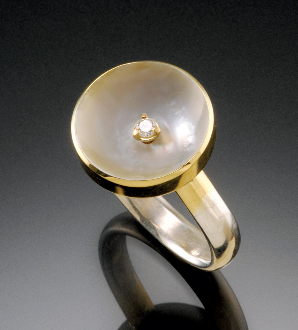 ANCIENT PEARL COLLECTION RING of eighteen karat yellow gold, fine silver and sterling silver with carved mother of pearl and inset diamond, 1.53 centimeters diameter, 2015.