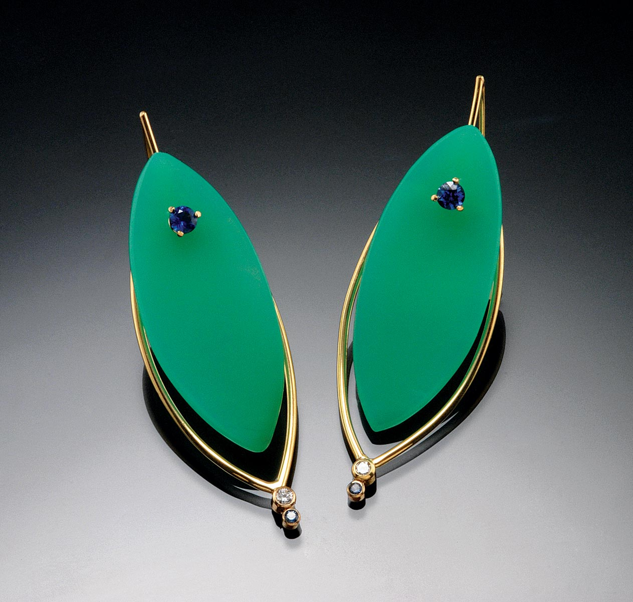 EARRINGS of carved green chrysoprase with faceted blue sapphires and diamonds in hand-fabricated eighteen karat yellow gold, 5.33 x 1.78 centimeters, 2013.