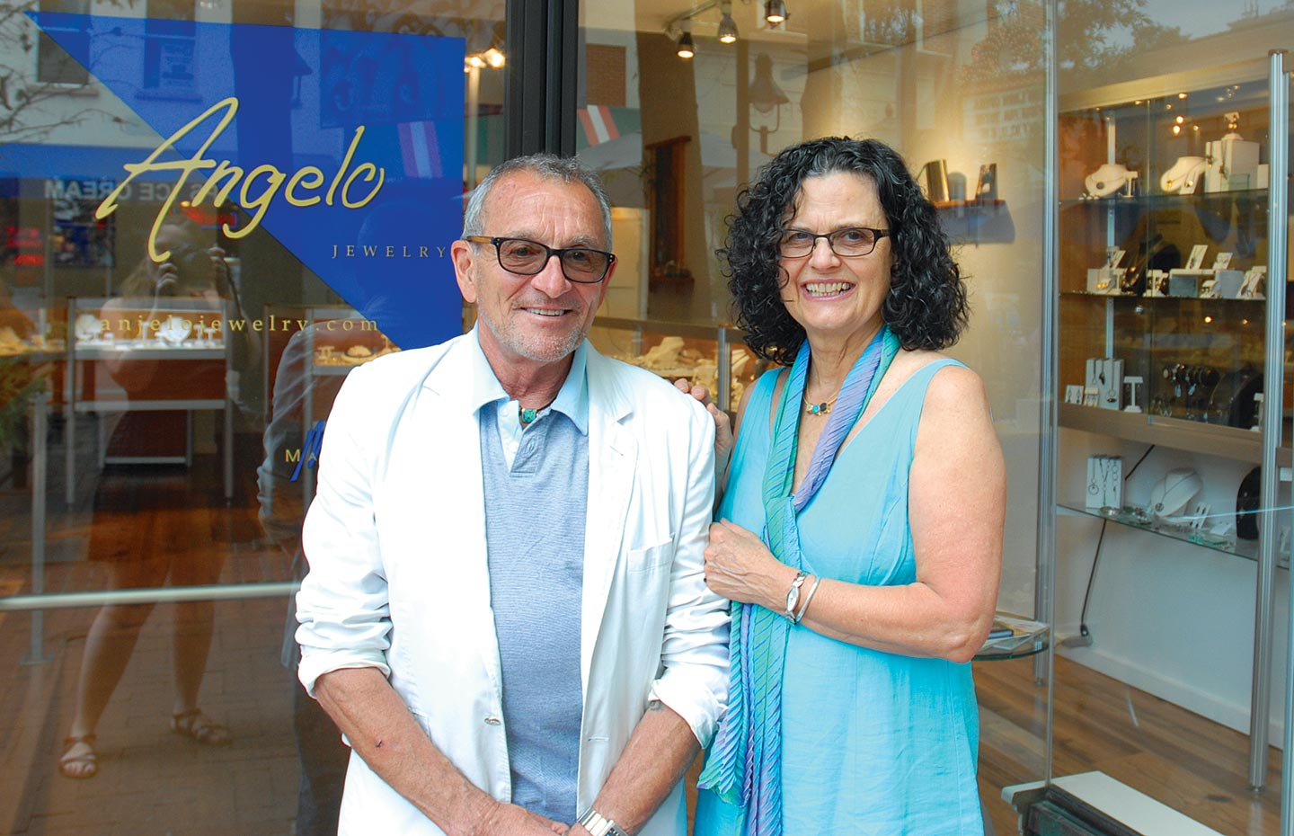 LEE MARRACCINI AND PAM PERUGI MARRACCINI standing in front of their store, Angelo Jewelry.