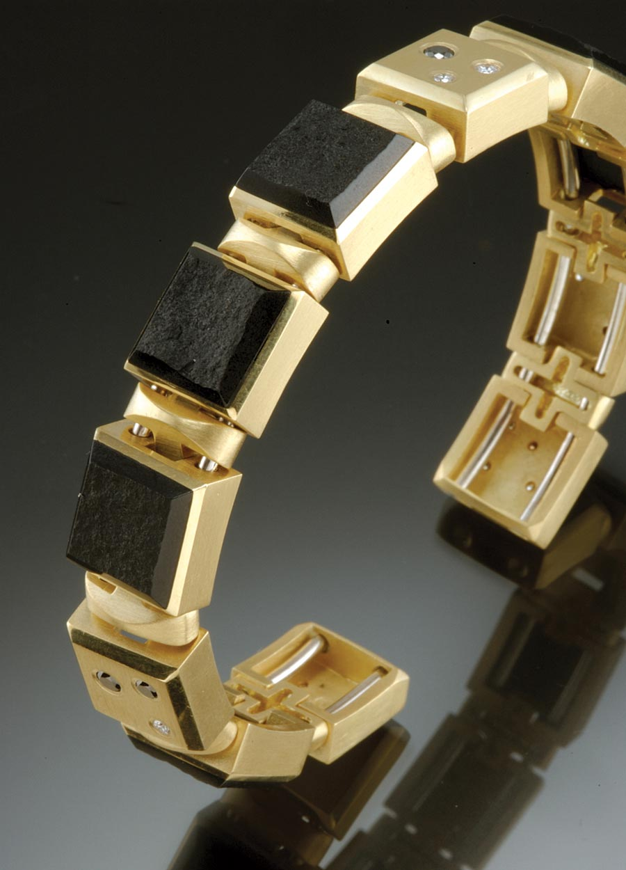 SPRING GOLD BRACELET of eighteen karat yellow gold with inlaid natural black jade and flushed set black and white diamonds, 16.51 x 1.27 x .64 centimeters, 1995.