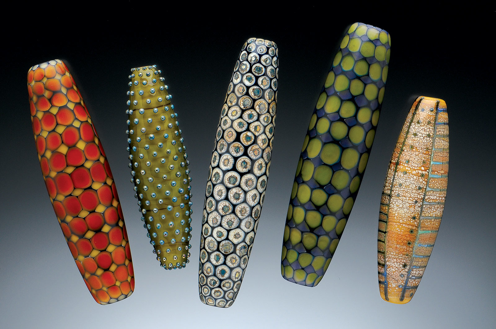 COLLECTION OF TOTEM BEADS of flameworked glass, largest bead 10 centimeters long, 2000-2003.  Photograph by Dean Powell.