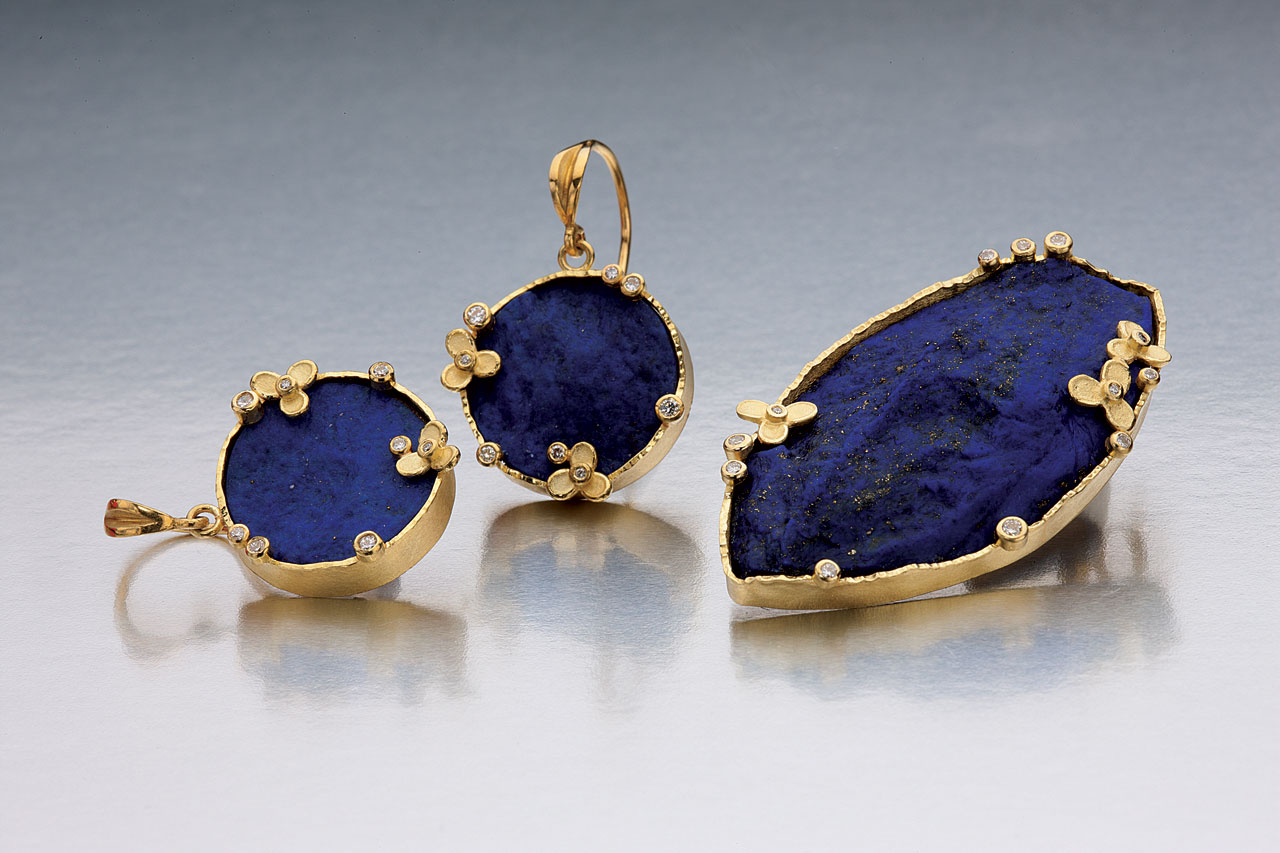 LAPIS EARRINGS AND BROOCH of eighteen karat yellow gold and diamonds, 2014.  Photograph by Tim Callahan.