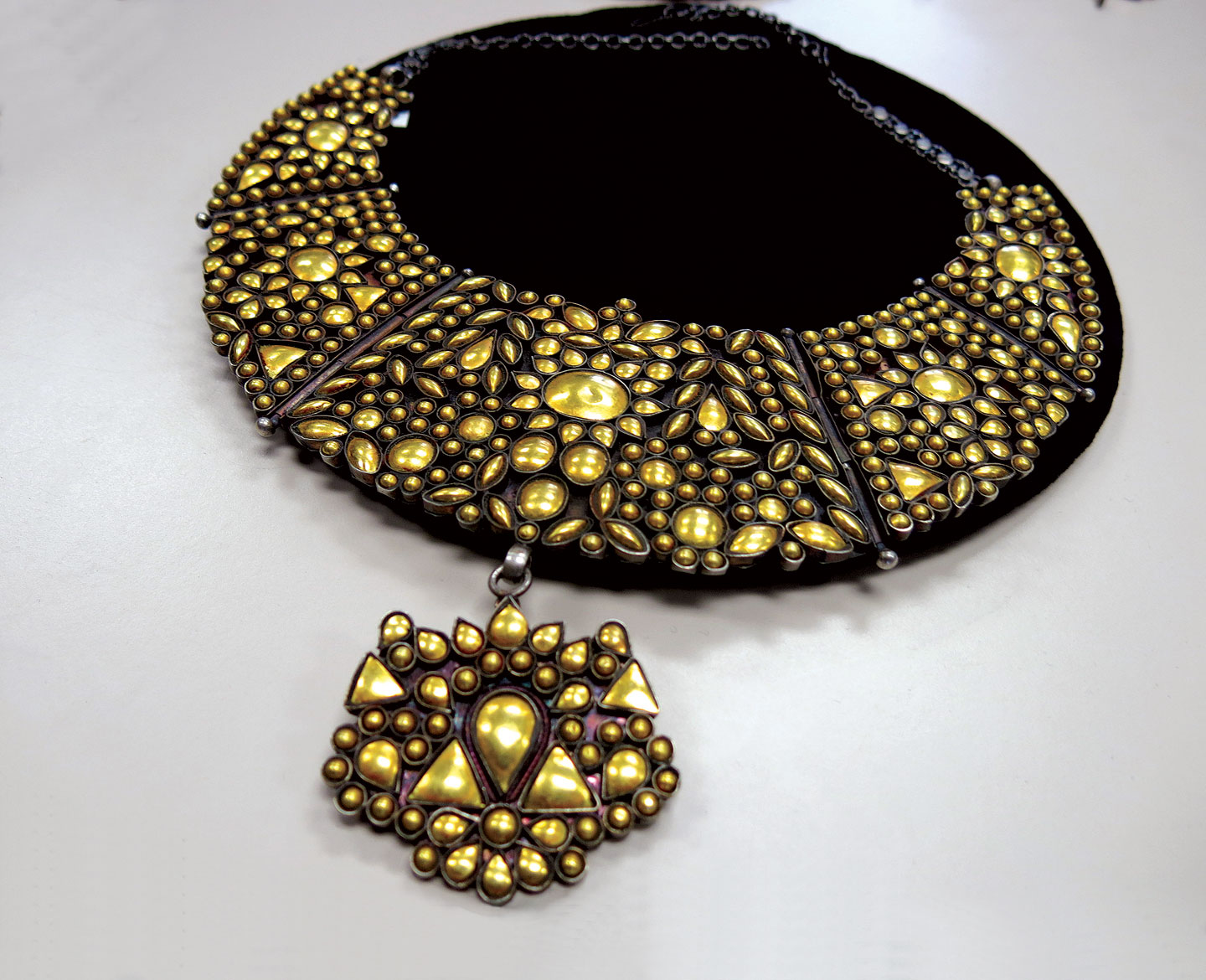 GOLD FOIL SILVER NECKLACE  (jodha)  by Bhagwan Das Soni. These designs use vintage jewelry, with silver domes covered in gold foil inserted into former gemstone settings.